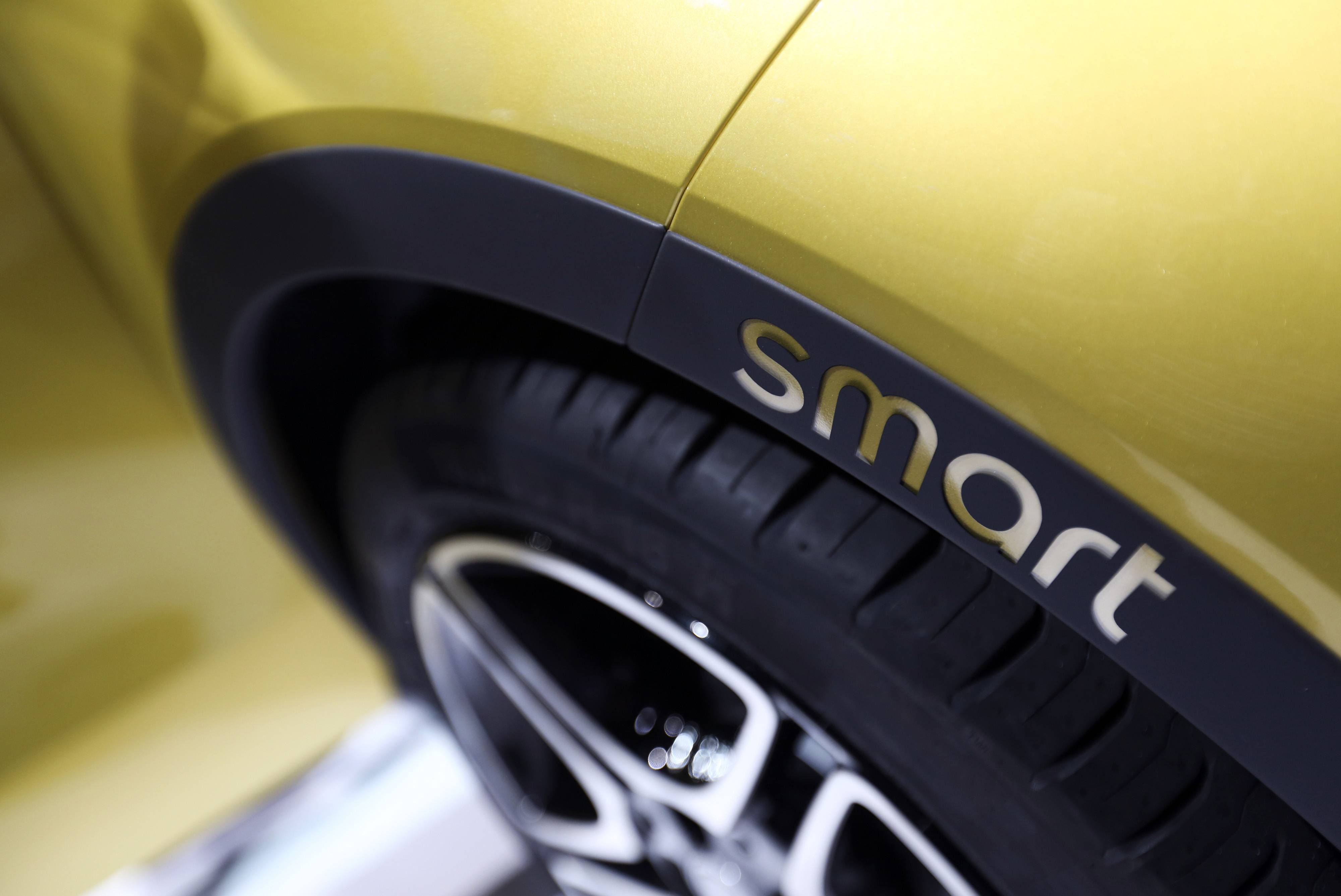 The wheel arch of a Smart ForFour electric automobile, manufactured by Daimler AG, is seen during the compact vehicle's world premiere in Berlin, Germany. Daimler's Smart brand unveiled a new version of its two-seat city car and revived a four-seat model as the sister division of luxury-vehicle maker Mercedes-Benz resumes a push to attract urban buyers.