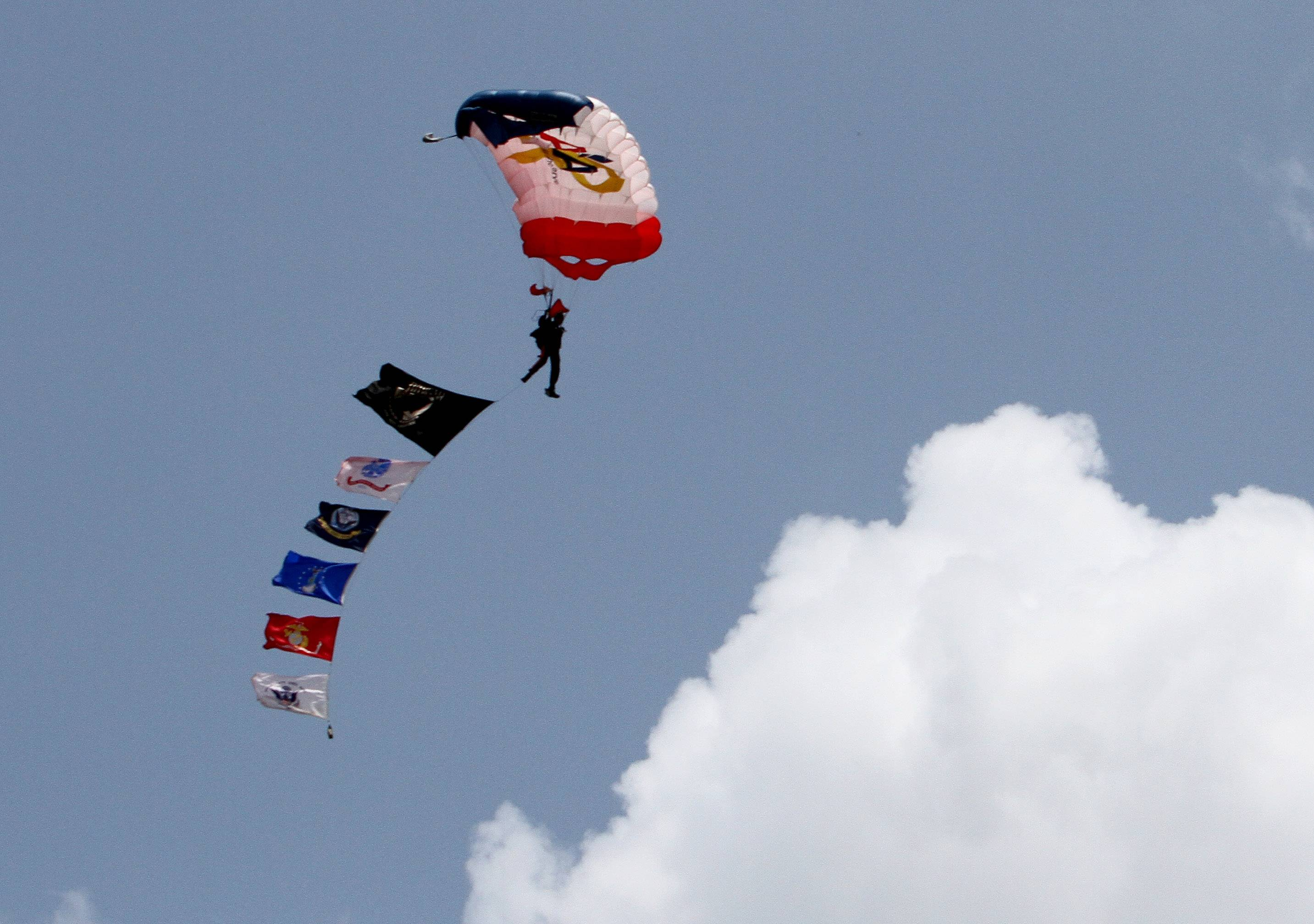 Members of the North Carolina-based All Veteran Parachute Team make a jump Friday into Cantigny Park in Wheaton. The team works with Lisle-based Operation Support Our Troops America to provide tandem sky-dives to veterans and Gold Star families.