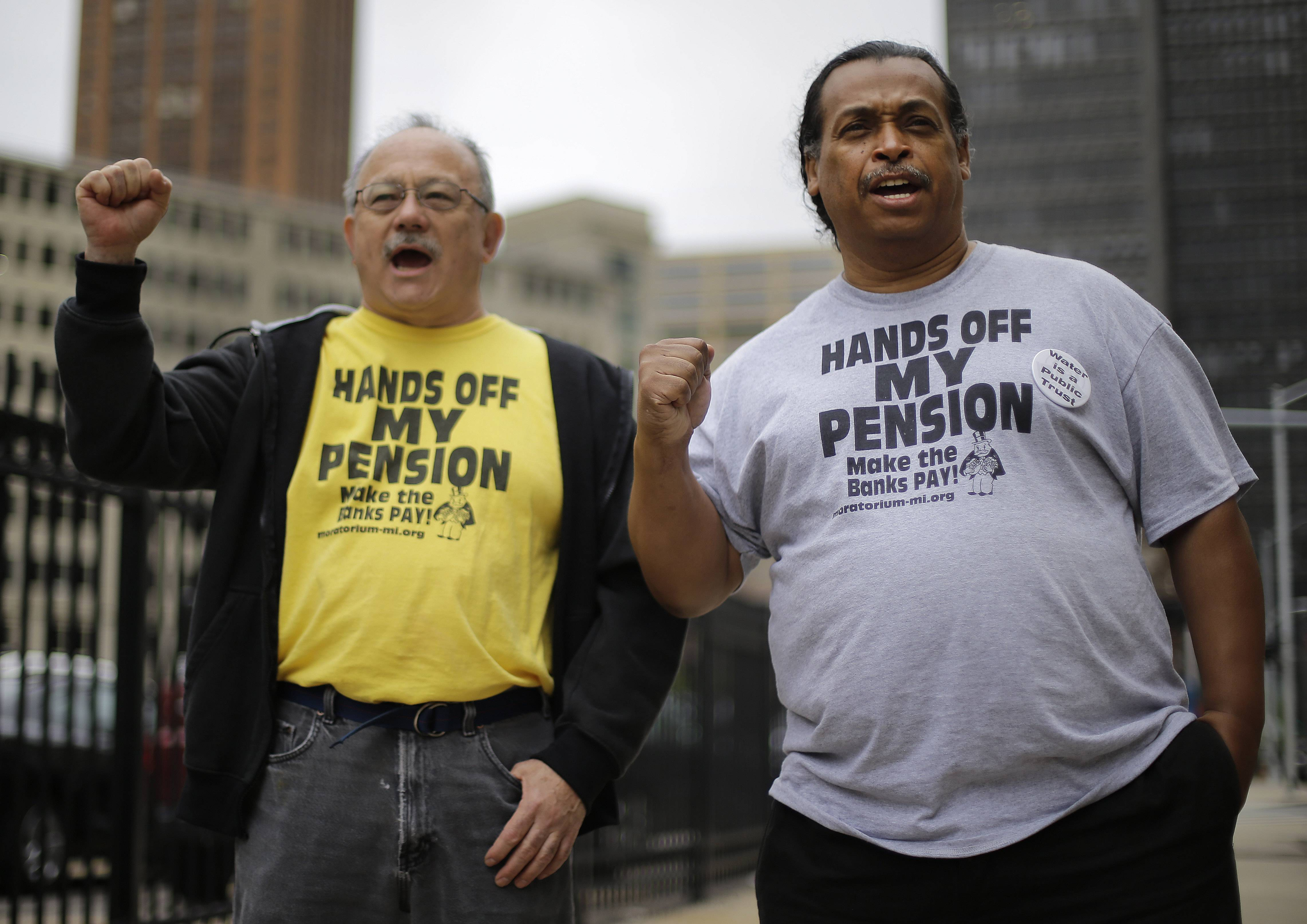 Detroit retirees Mike Shane, left, and William Davis protest near the federal courthouse in Detroit July 3. Ballots submitted by city workers, retirees, pensioners and other creditors likely will determine how quickly Detroit exits its historic bankruptcy. A major piece of the bankruptcy puzzle could fall into place Monday with the expected release of the results of a vote by creditors, including more than 30,000 retired and current city workers, on whether to accept millions of dollars in cuts.