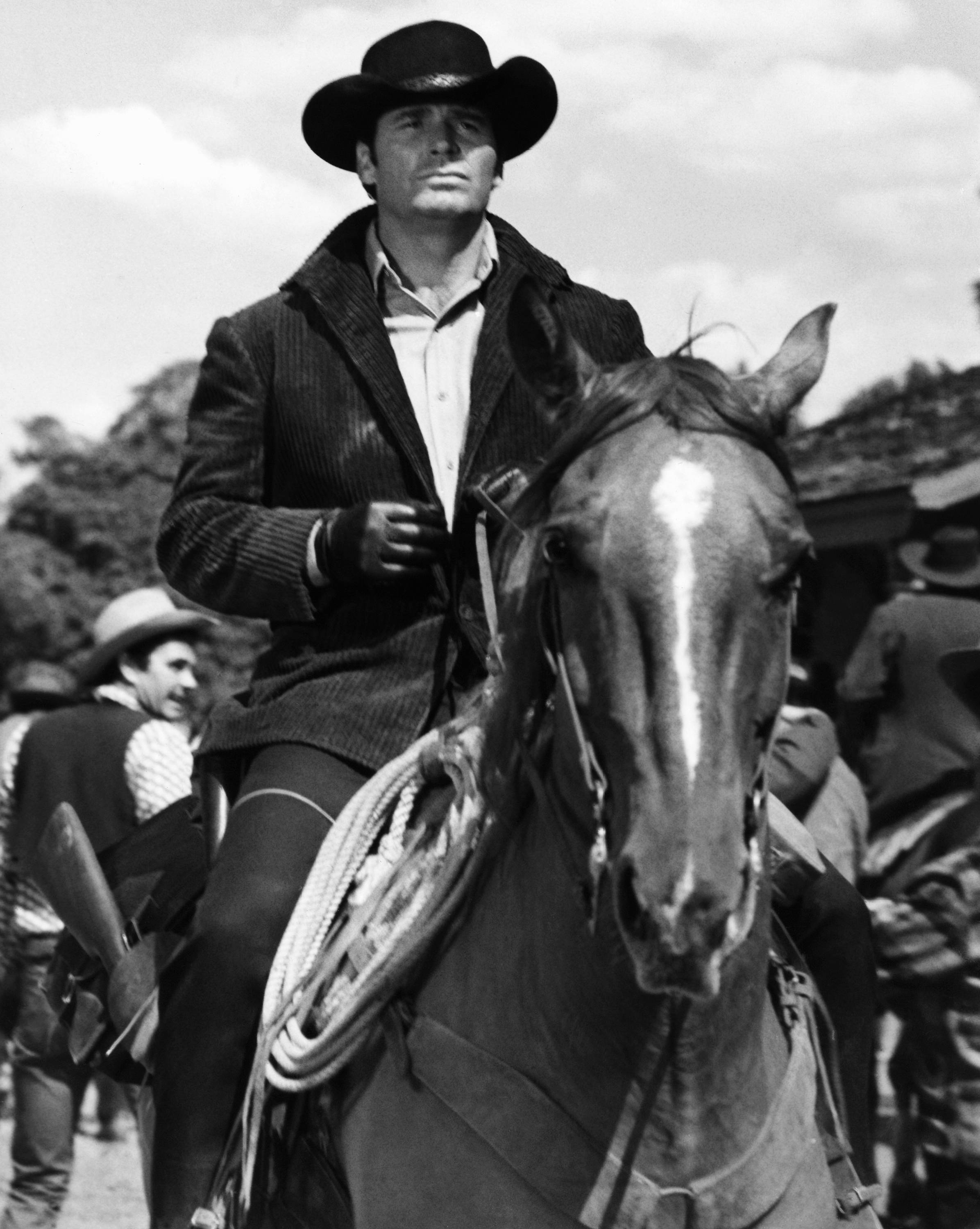 "James Garner as Australia- bound Jason McCullough rides into gold-rush boom town of Calendar in this April 1968 file photo taken at MGM Studios. Actor James Garner, wisecracking star of TV's ""Maverick"" who went on to a long career on both small and big screen, died Saturday July 19, 2014 according to Los angeles police. He was 86."