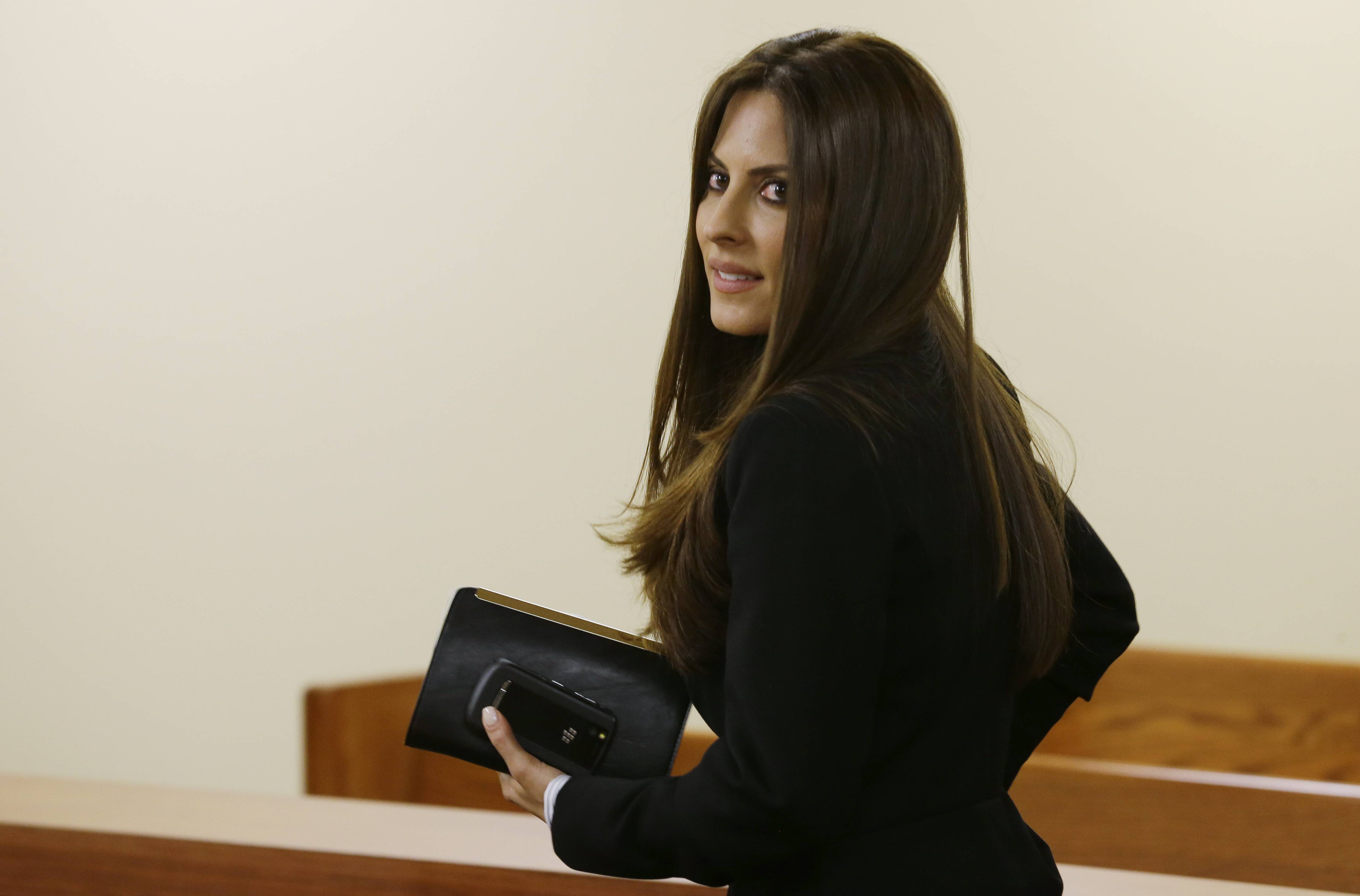 In this May 30 photo, Kerri Kasem, the daughter of ailing radio personality Casey Kasem, leaves Kitsap County Superior Court in Port Orchard, Wash. A judge in Washington state has granted Kasem's daughter a temporary restraining order preventing the famous radio host's wife, Jean Kasem, from cremating or removing his remains from a funeral home.