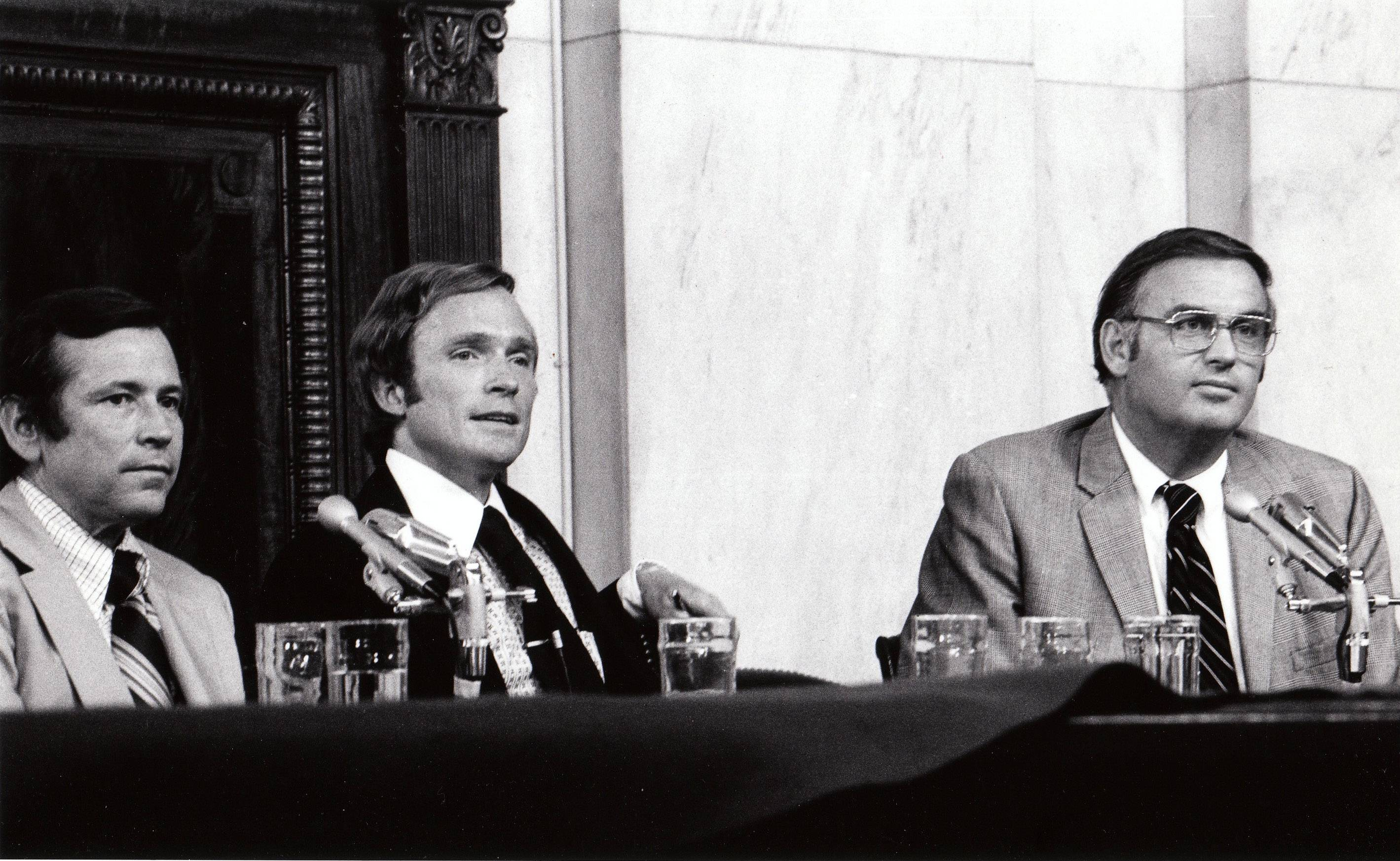 "This Aug. 1, 1973, file photo shows host Dick Cavett of ""The Dick Cavett Show,"" center, on location in the Senate Watergate Committee hearing room in Washington with Committee Vice-Chairman, Sen. Howard Baker, left, and Sen. Lowell Weicker. PBS is marking the 40th anniversary of President Richard Nixon's resignation by running a documentary on the Watergate scandal seen through the prism of Cavett's late-night talk show at the time."