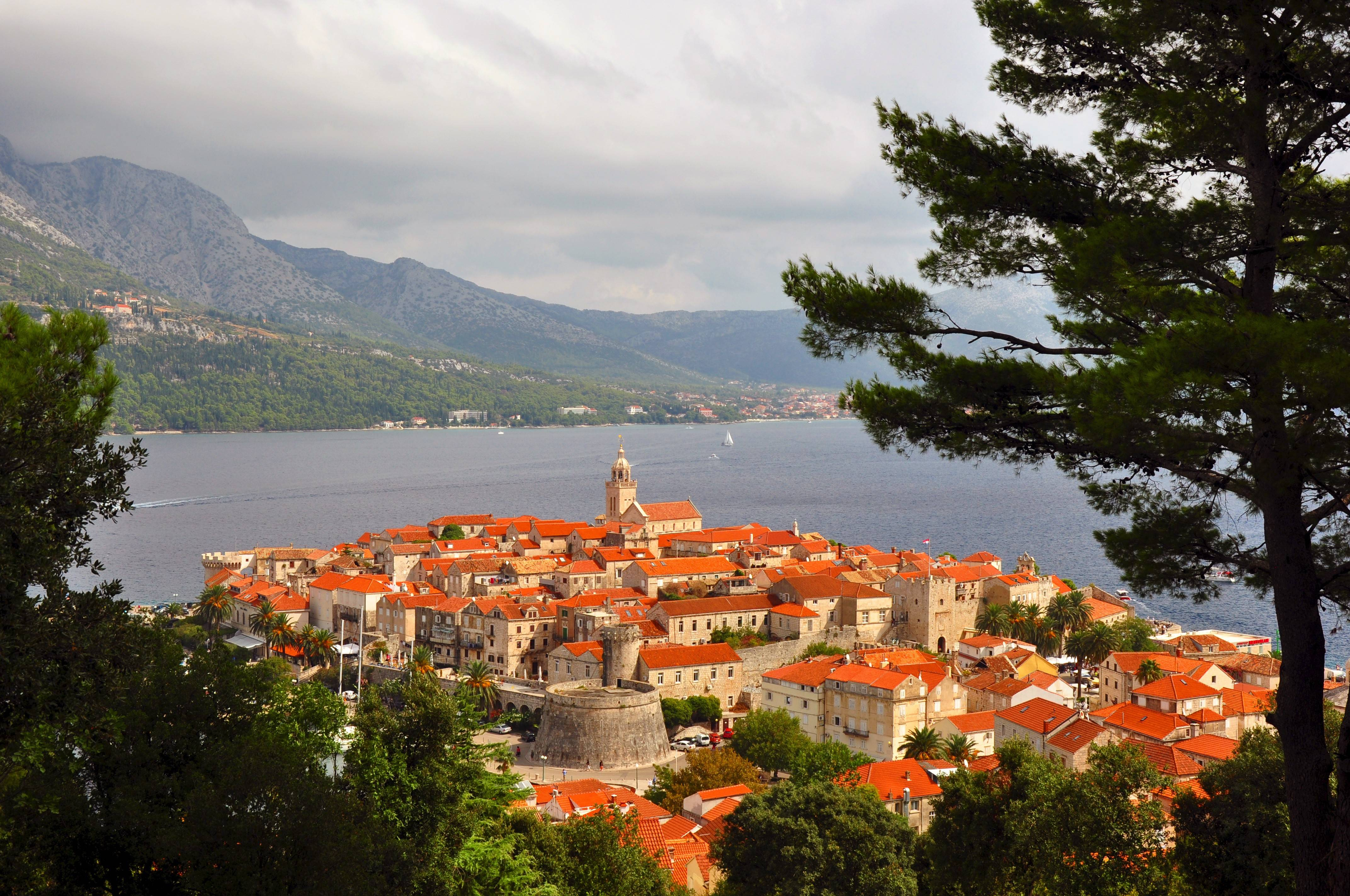 The walled old town of Korcula rises from an oval peninsula on Korcula Island in Croatia.