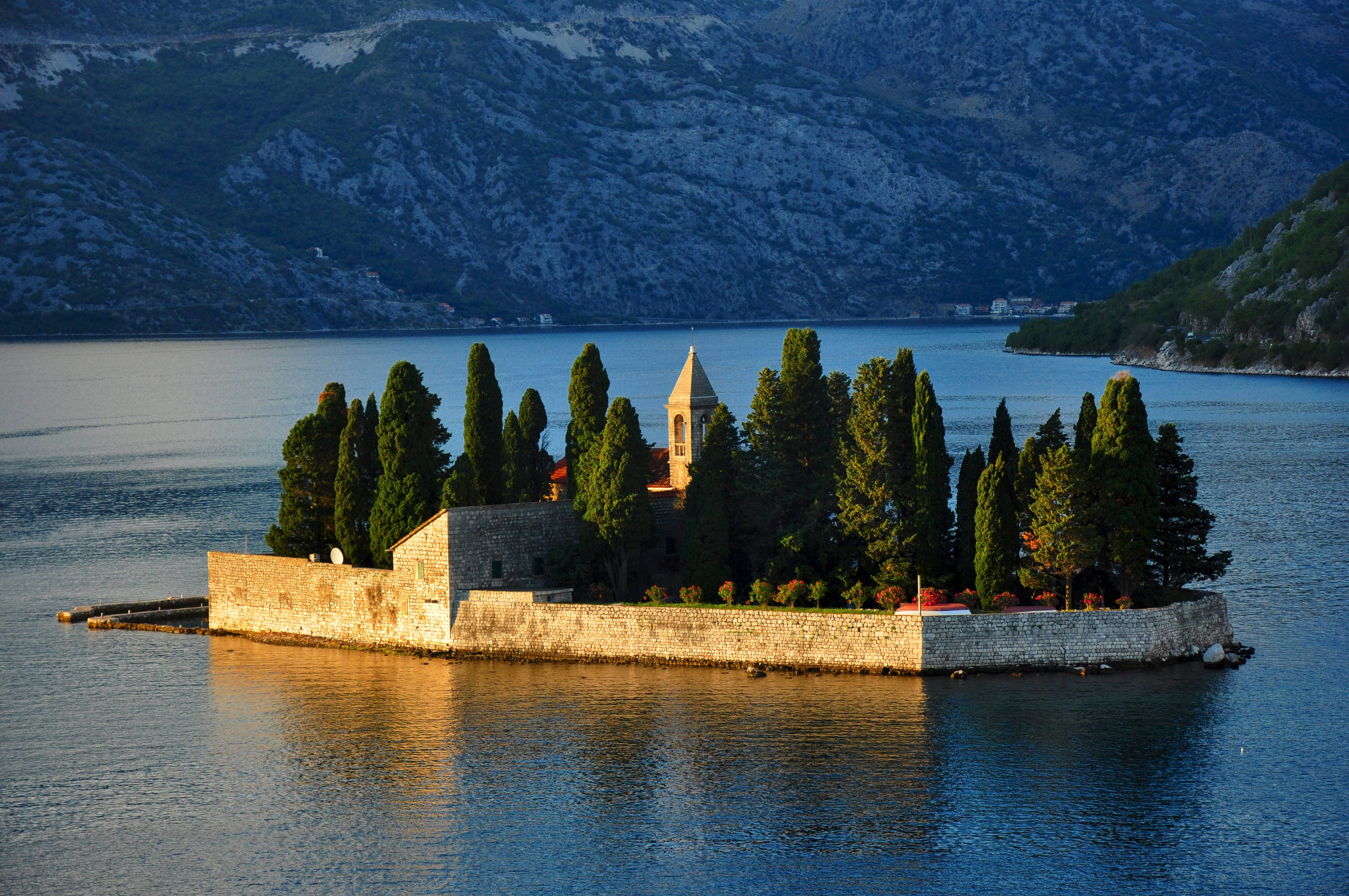 Tiny islands seem to pop up from Montenegro's Bay of Kotor.