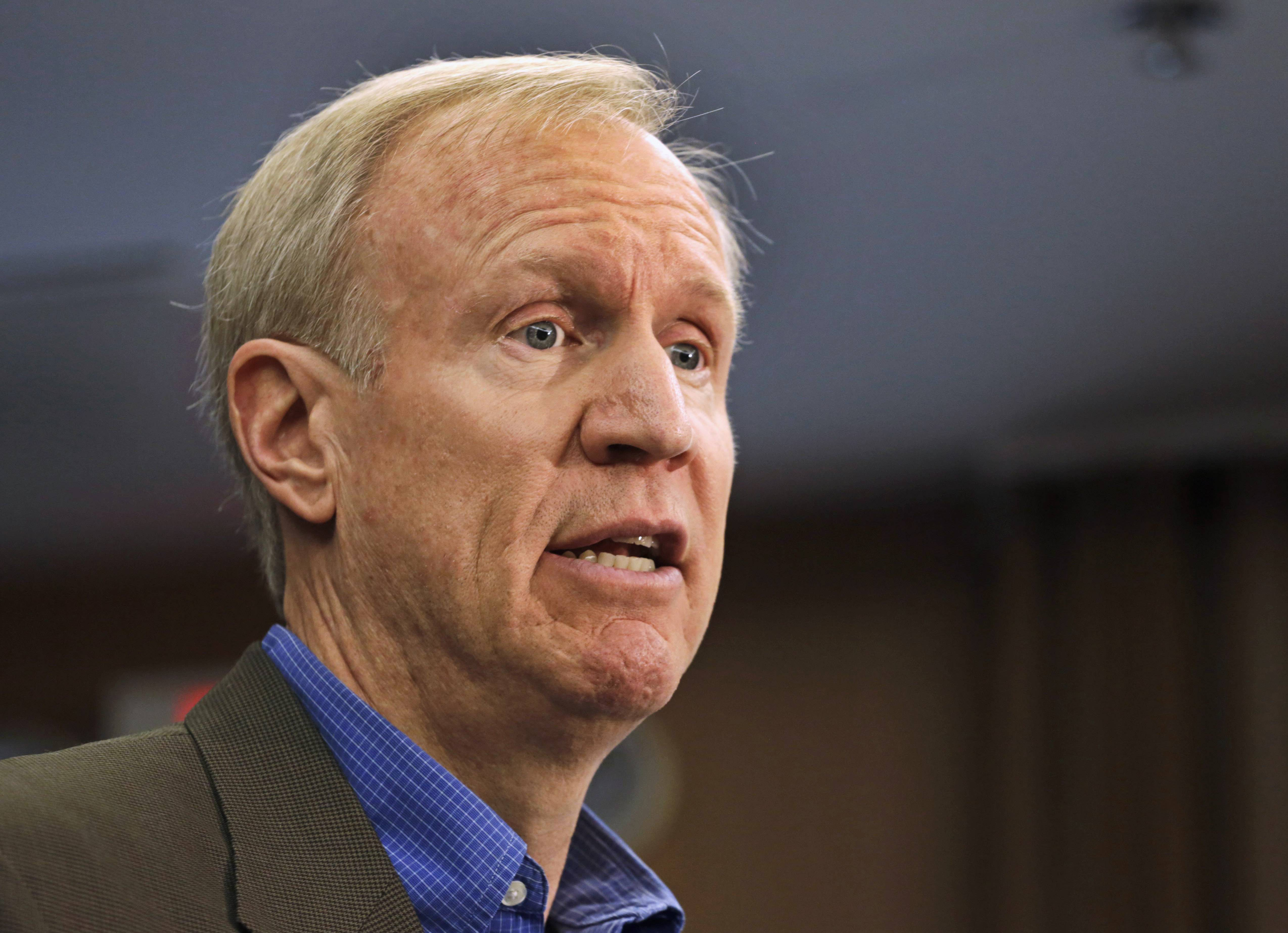 Illinois Republican gubernatorial candidate Bruce Rauner, seen here speaking at a news June 12 conference in Chicago, says Gov. Quinn's time in office has hurt the jobs outlook in Illinois not helped.