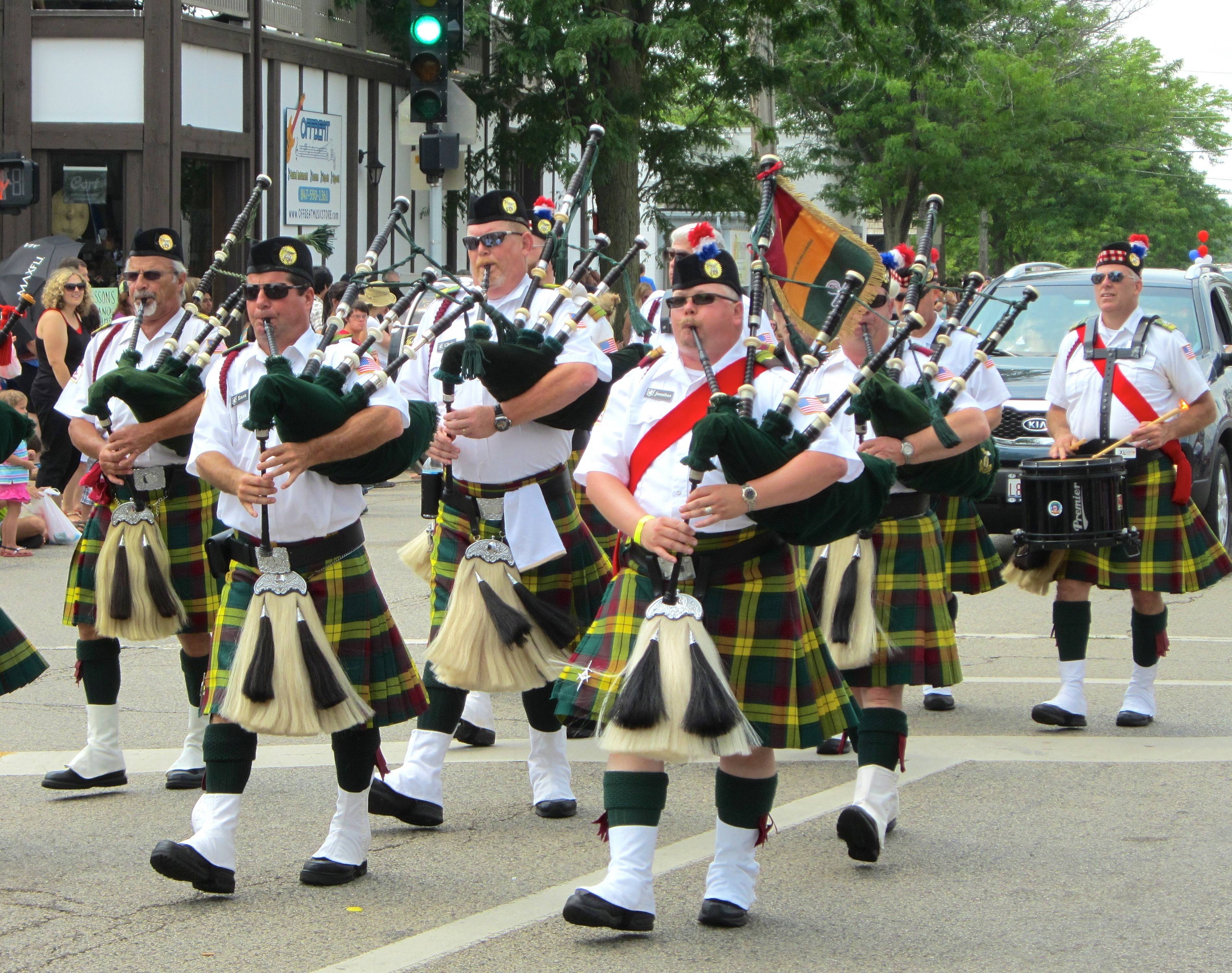 Bagpipers deliver their distinctive, soaring sounds during the Alpine Fest Parade on Sunday in Lake Zurich. The parade along Main Street in the village's downtown kicked off the last day of the annual summer event Alpine Fest.