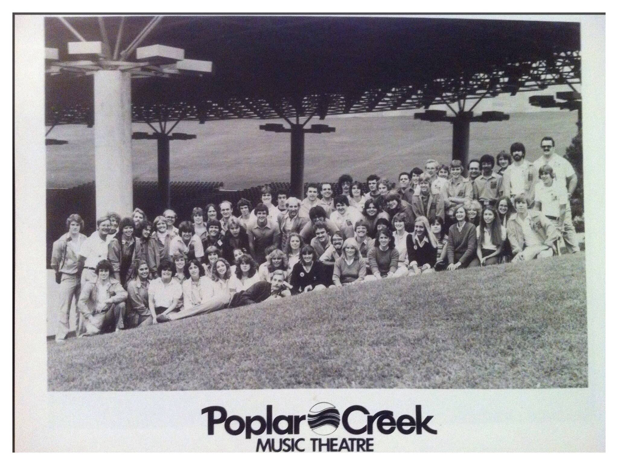 The staff poses on the lawn at the old Poplar Creek Music Theatre in Hoffman Estates.