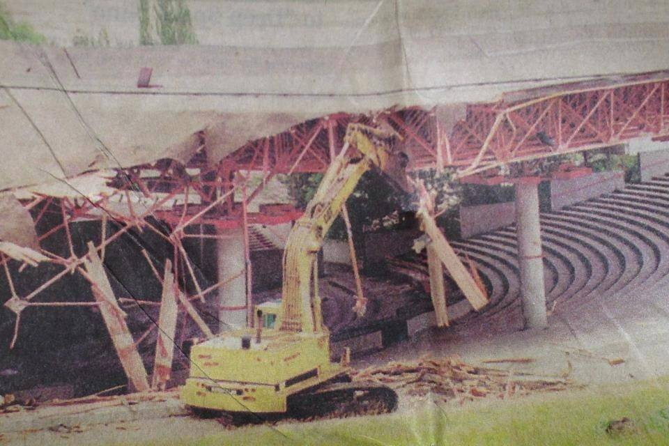 In this undated photo, a bulldozer tears down Poplar Creek Music Theatre in Hoffman Estates. The venue housed some of music and comedy's biggest acts between 1980 and 1994, when it closed.