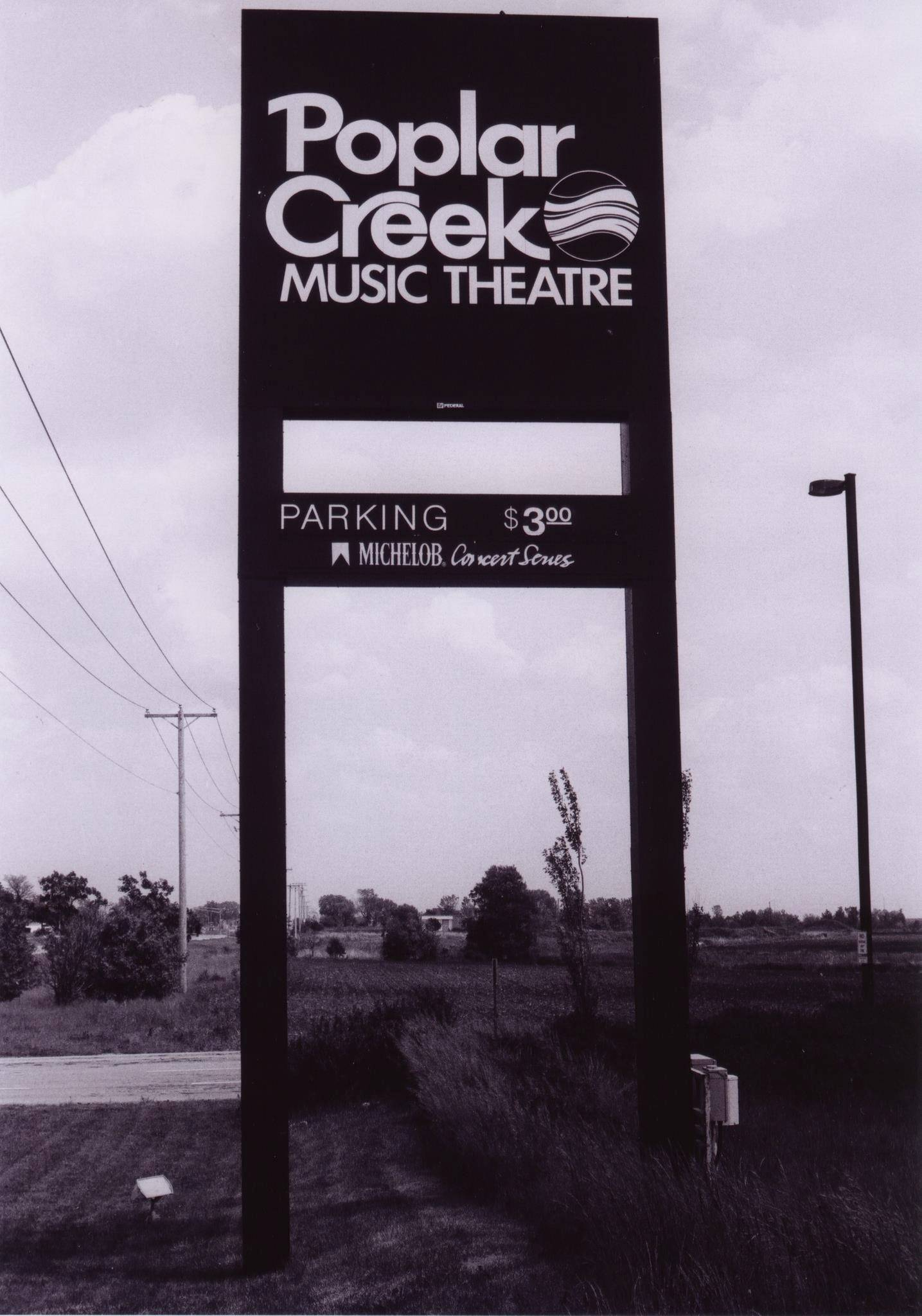 A sign, and notice of the $3 parking fee, welcomes people to the old Poplar Creek Music Theatre in Hoffman Estates.