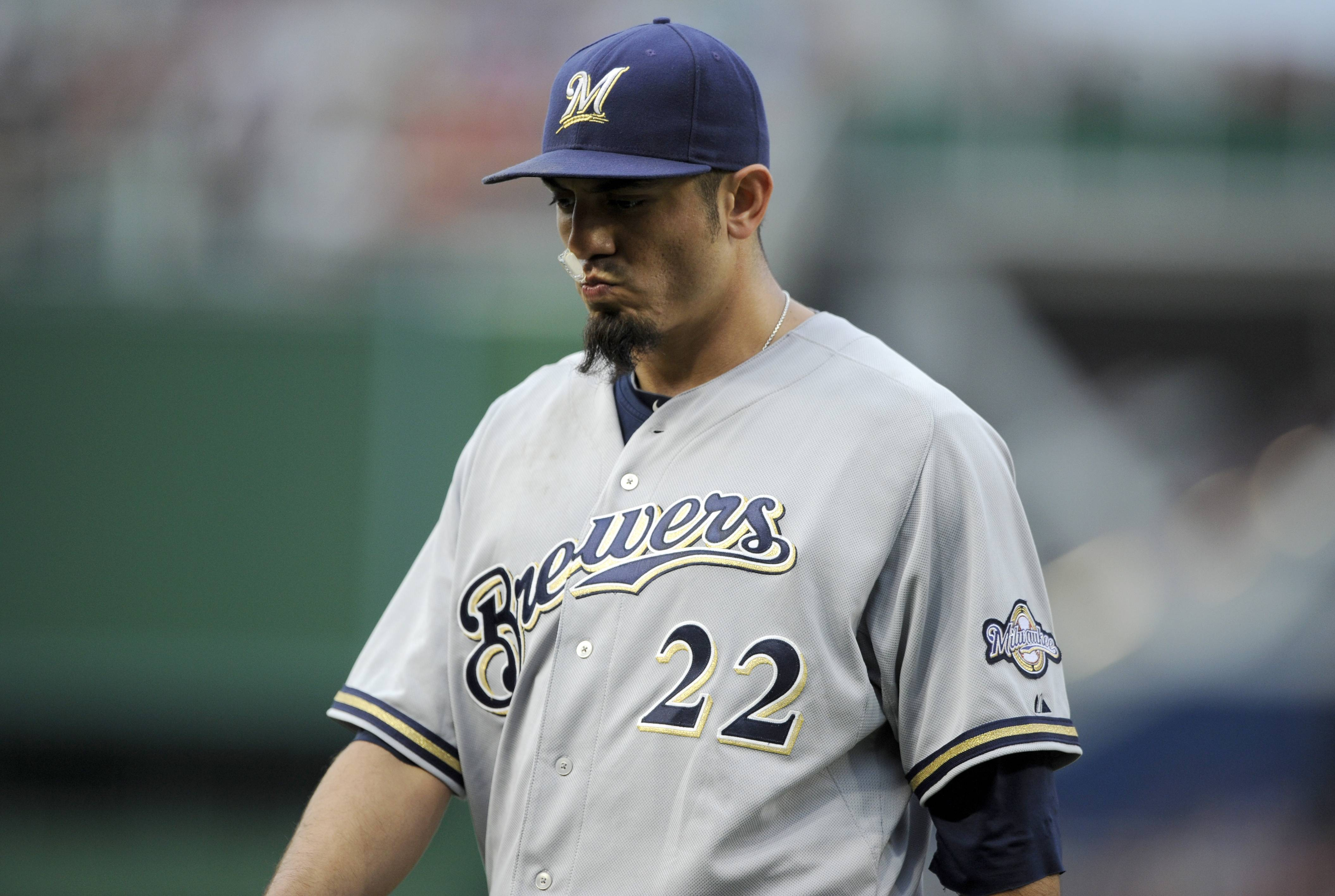 Milwaukee Brewers starting pitcher Matt Garza heads to the dugout after he was pulled from the baseball game against the Washington Nationals during the first inning Saturday, July 19, 2014, in Washington.