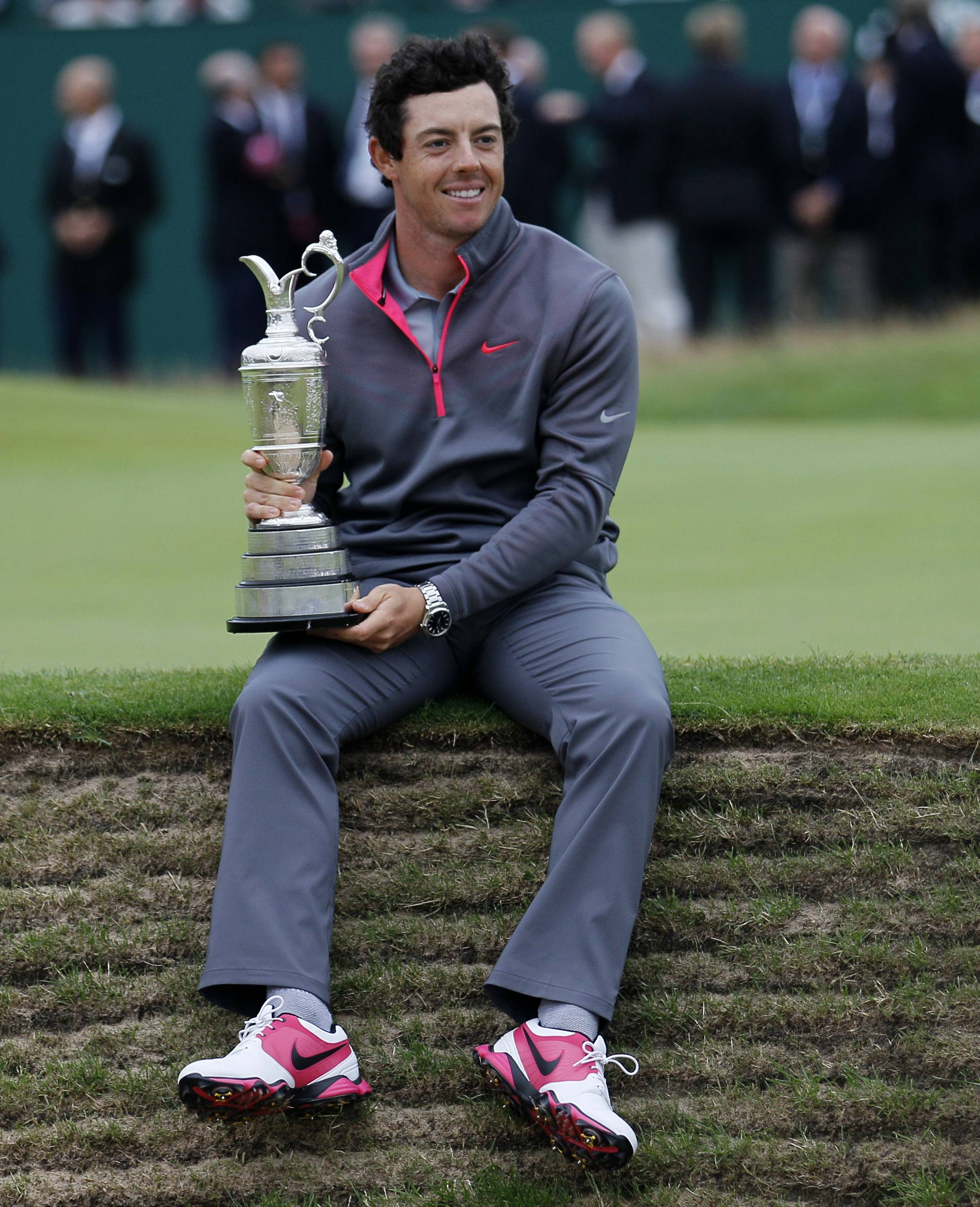 Rory McIlroy holds the claret jug after finishing his wire-to-wire British Open victory, his third major in the career grand slam. McIlroy already is thinking about next year's Masters.