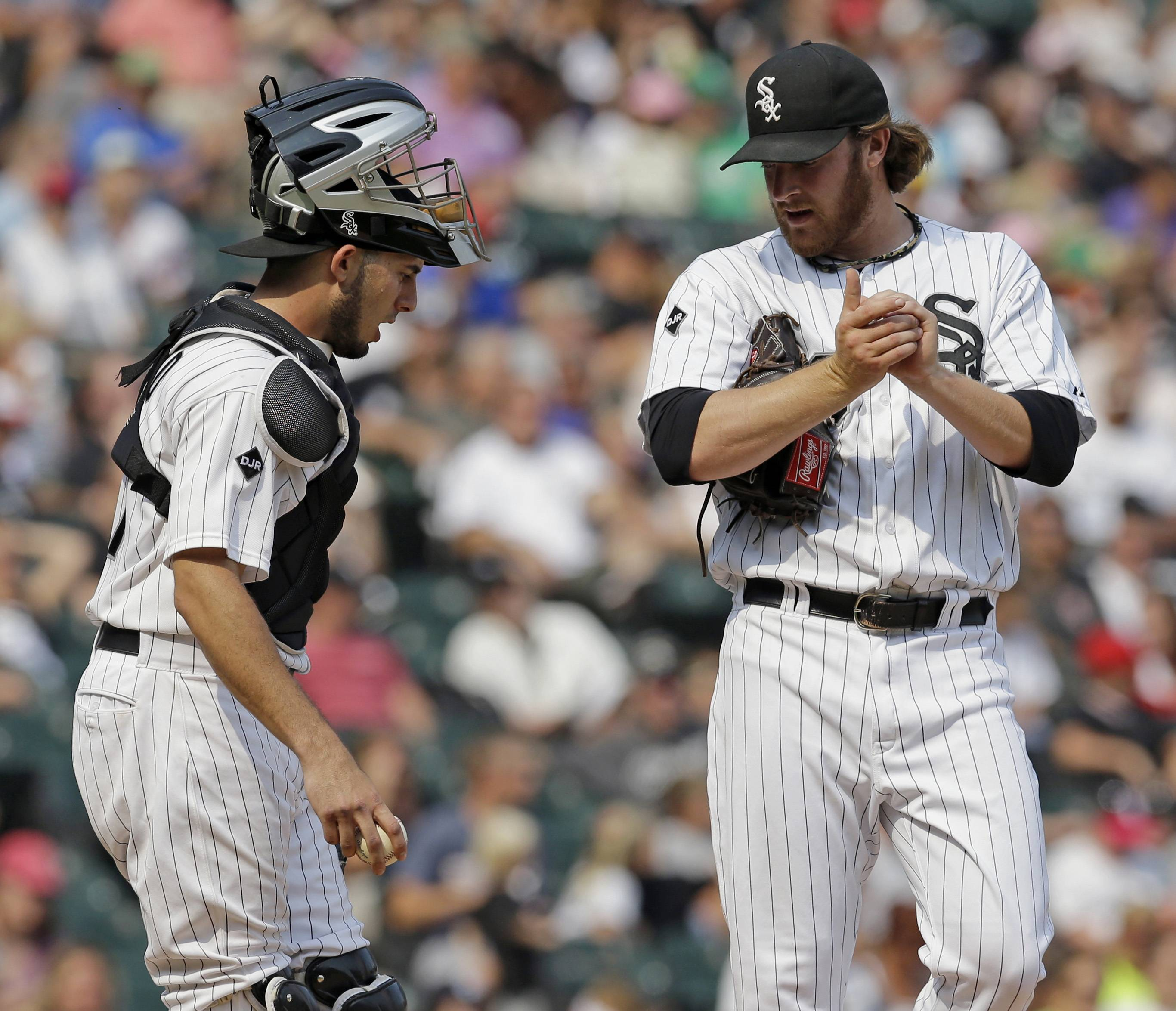 White Sox catcher Adrian Nieto talks to relief pitcher Daniel Webb during the seventh inning, when the Astros scored 4 runs after the Sox had finally battled back to tied the game at 7-7.