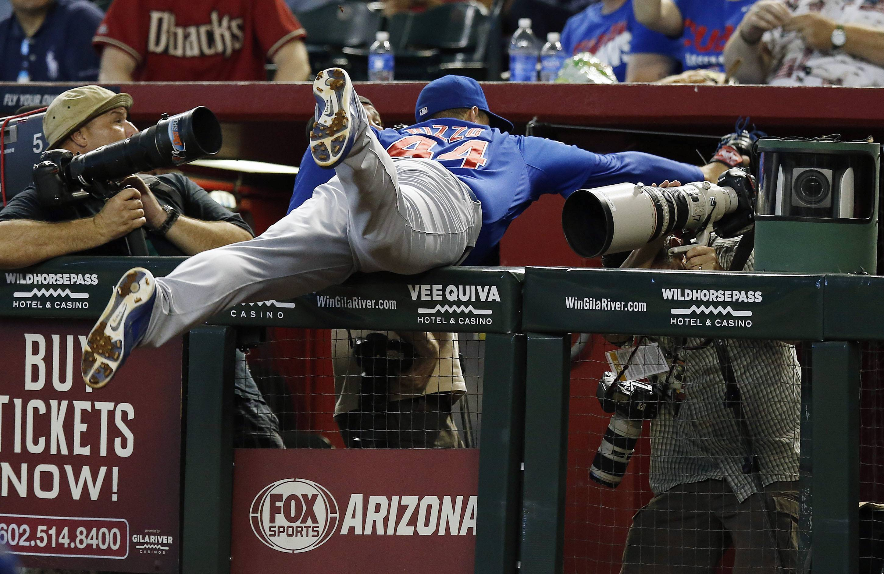 The Cubs' Anthony Rizzo makes a diving catch into the photo well on a foul ball hit by Arizona's Aaron Hill during the sixth inning Sunday in Phoenix.