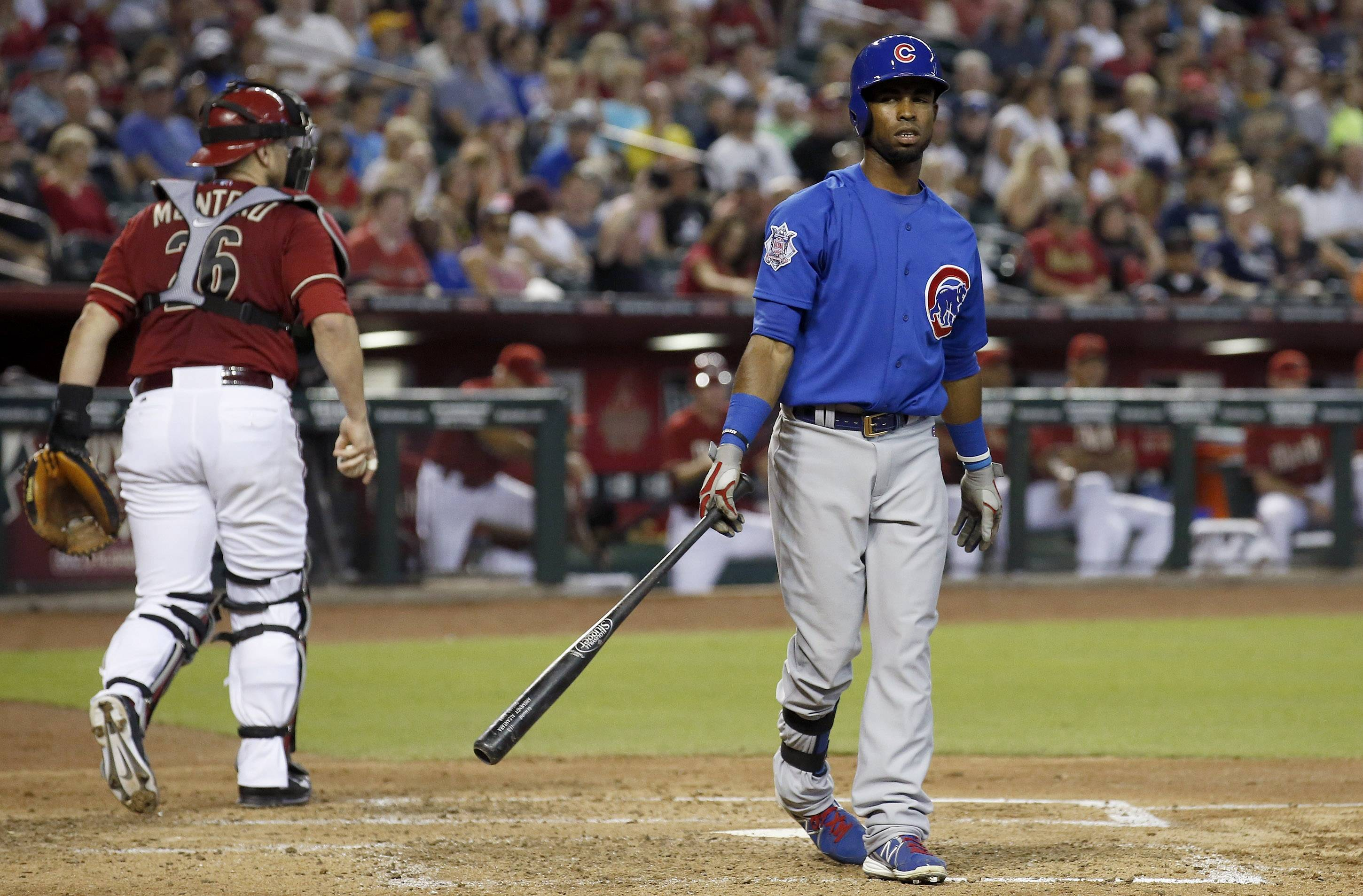 The Cubs' Arismendy Alcantara walks back to the dugout after striking out in the third inning Sunday in Arizona.