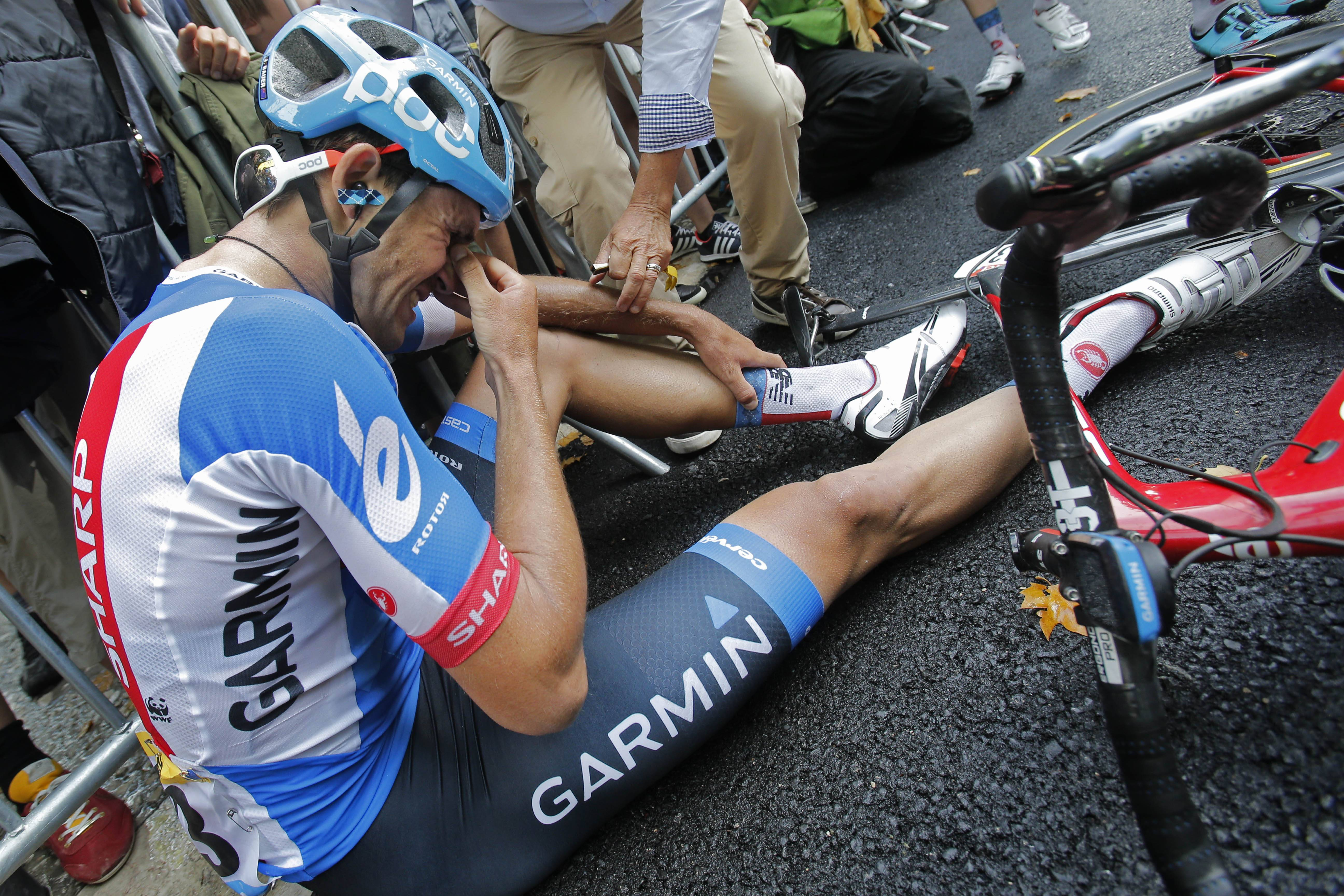 New Zealand's Jack Bauer, who rode in the two-man breakaway all of the race, cries Sunday after being caught in the last meters of the 15th stage of the Tour de France.