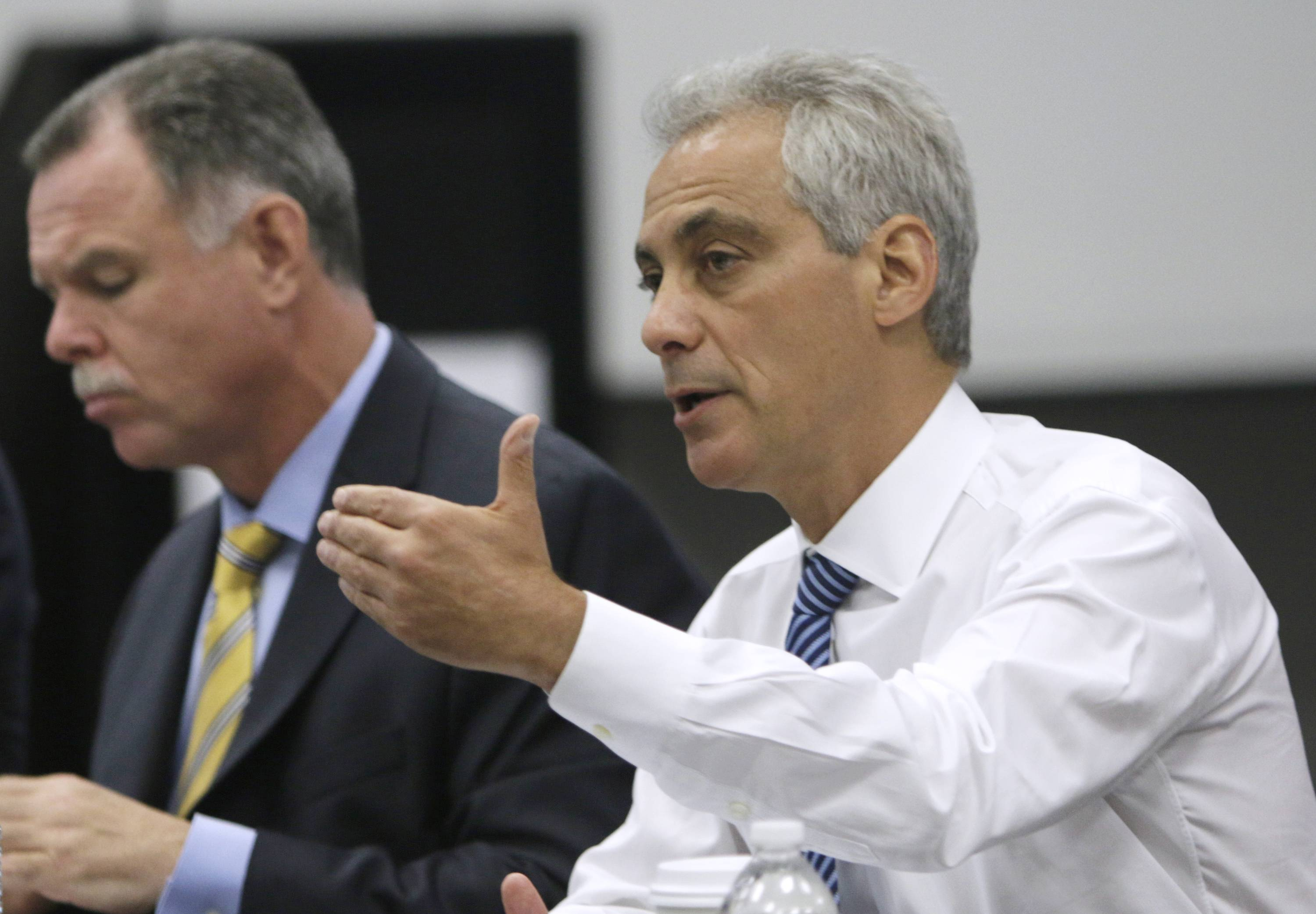 Chicago Mayor Rahm Emanuel, right, speaks while Chicago Police Superintendent Garry McCarthy listens during a news conference Monday. Emanuel met with law enforcement and school officials to talk about the city's violence problem.