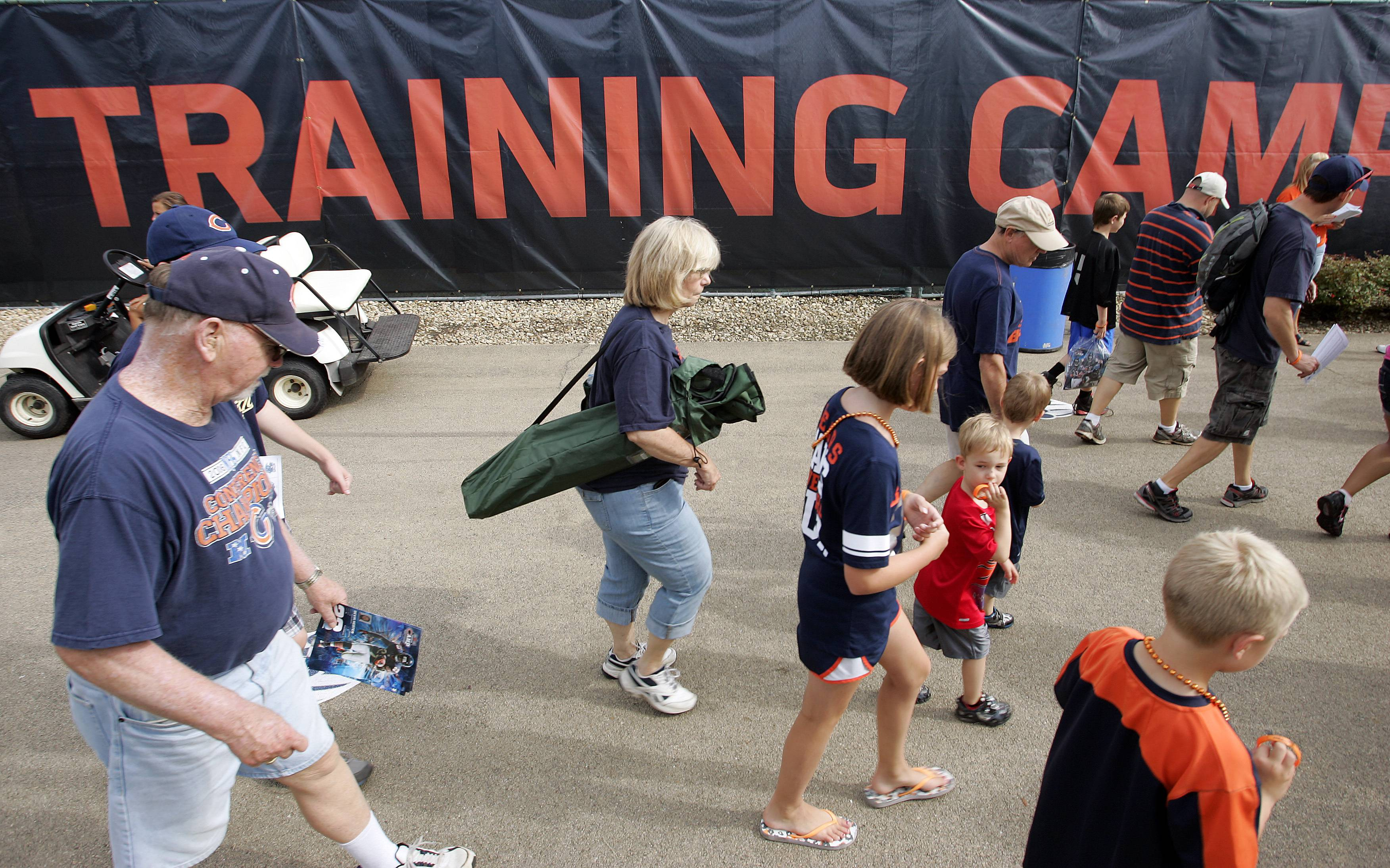 Fans arrive at the Bears training camp on the campus of Olivet Nazarene University in Bourbonnais.