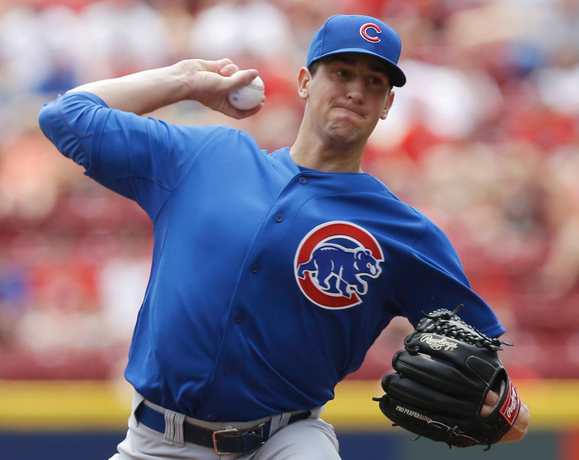 Cubs starting pitcher Kyle Hendricks (28) throws against the Cincinnati Reds in the first inning of a baseball game, Thursday, July 10, 2014, in Cincinnati. Hendricks was making his major league debut.