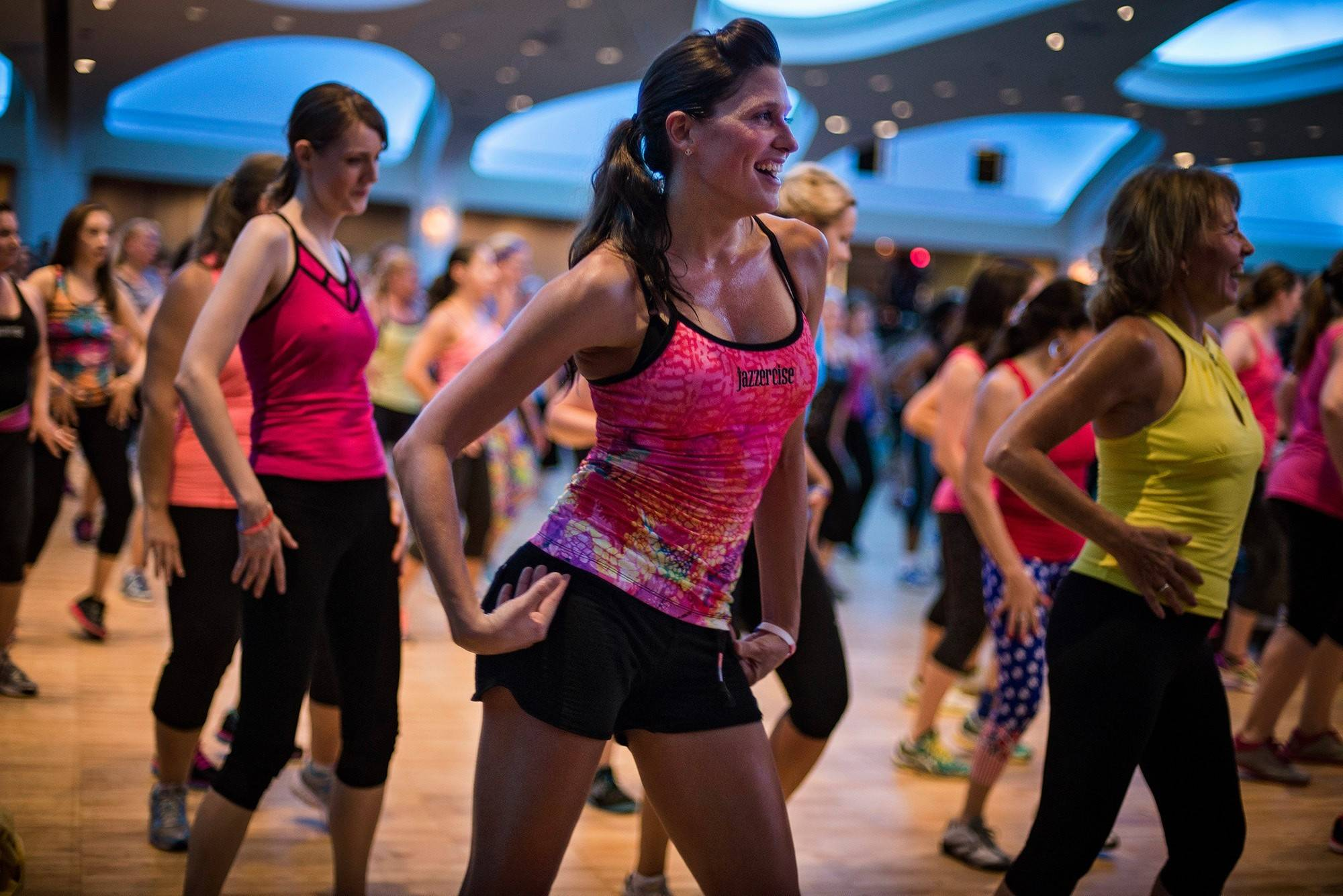 Kristen Smith dances at a Jazzercise Live event led by Jazzercise founder Judi Sheppard Missett.