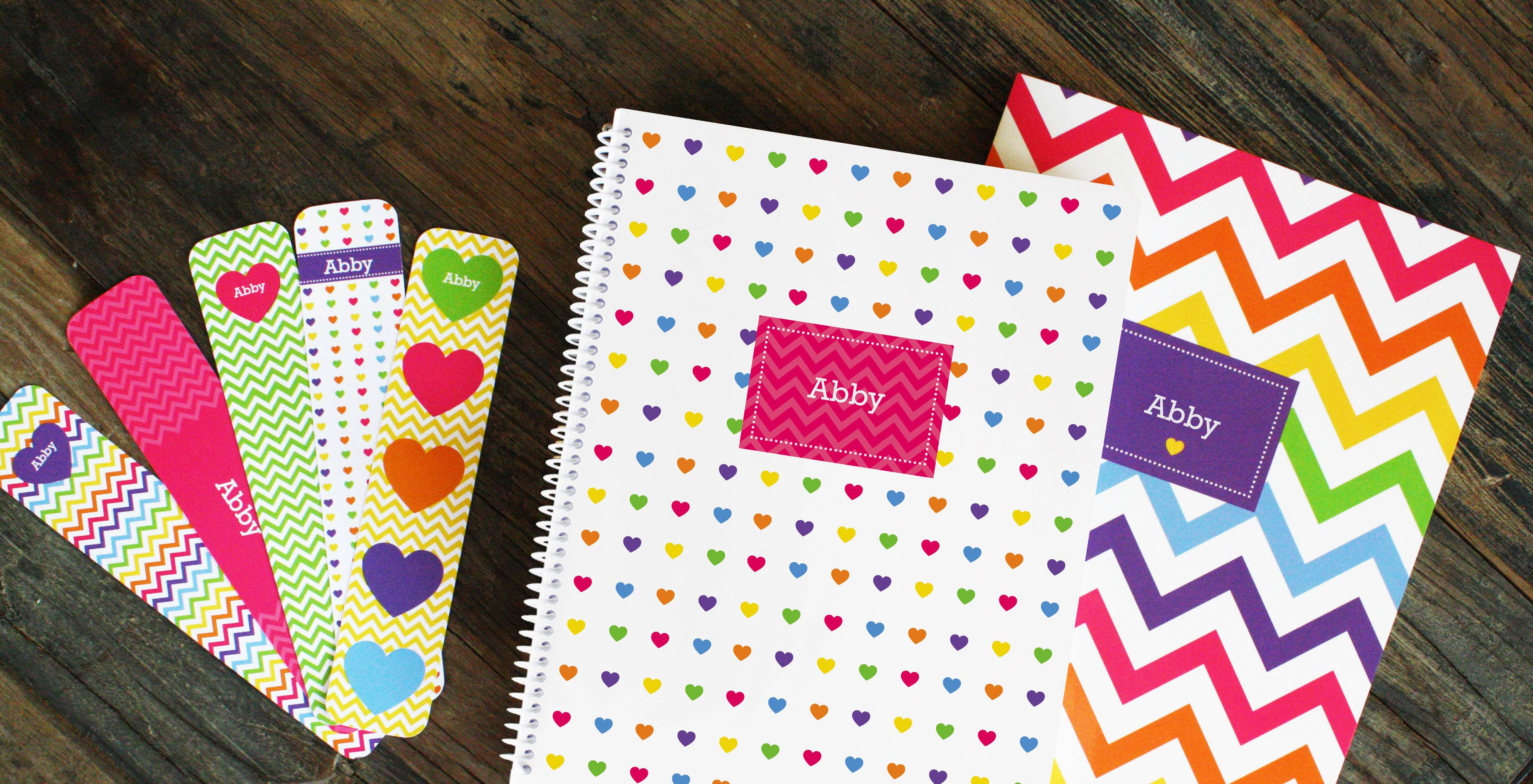 Geometrics and graphic prints put a preppy spin on notebooks that can be personalized with kids' names or initials.