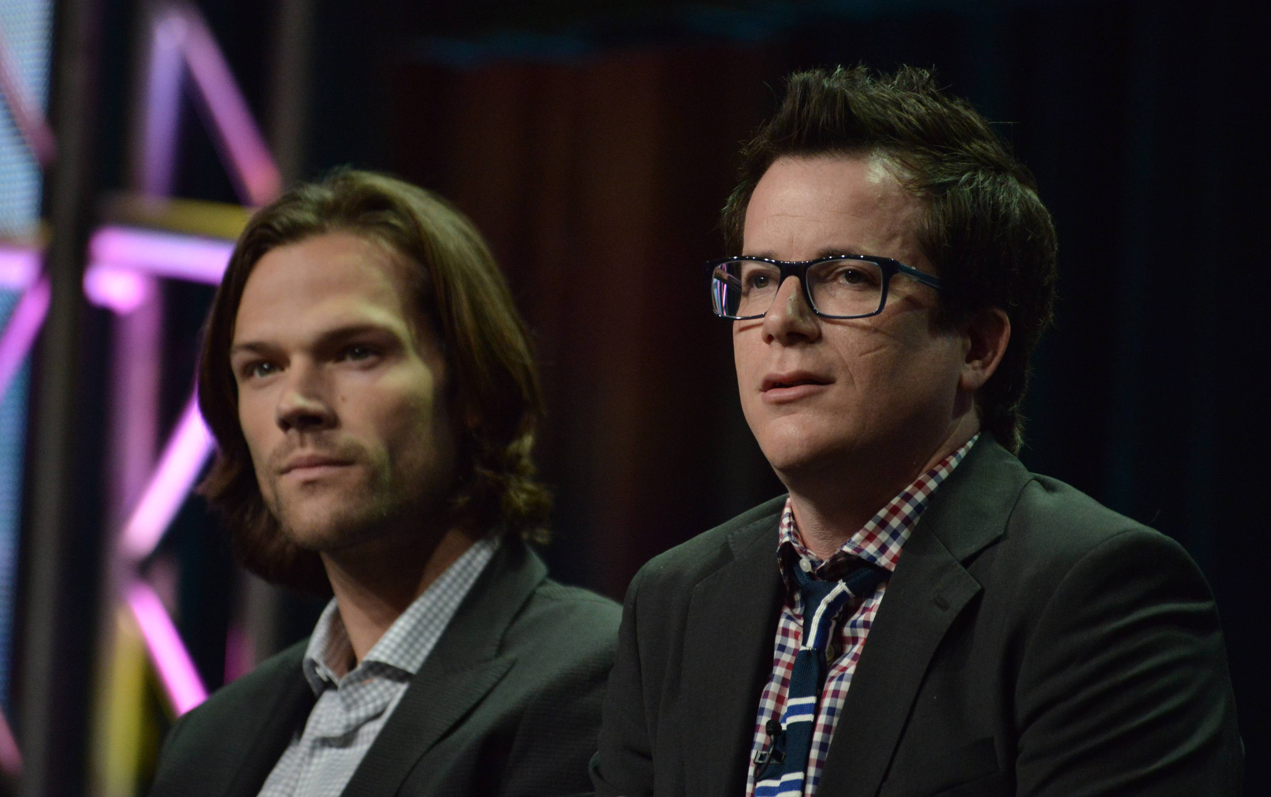 "Jared Padalecki, left, and producer Jeremy Carver speak on stage during the ""Supernatural"" panel at The CW 2014 Summer TCA held at the Beverly Hilton Hotel on Friday."