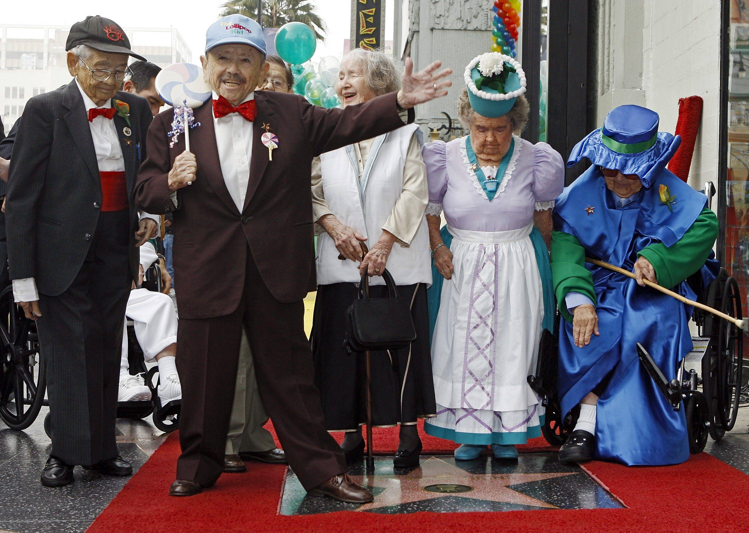 "In 2007, Munchkins from ""The Wizard of Oz"" celebrate receiving a star on the Hollywood Walk of Fame at Grauman's Chinese Theatre, site of the film's 1939 premiere. The film is the subject of a new book by Arlington Heights writer David J. Hogan."