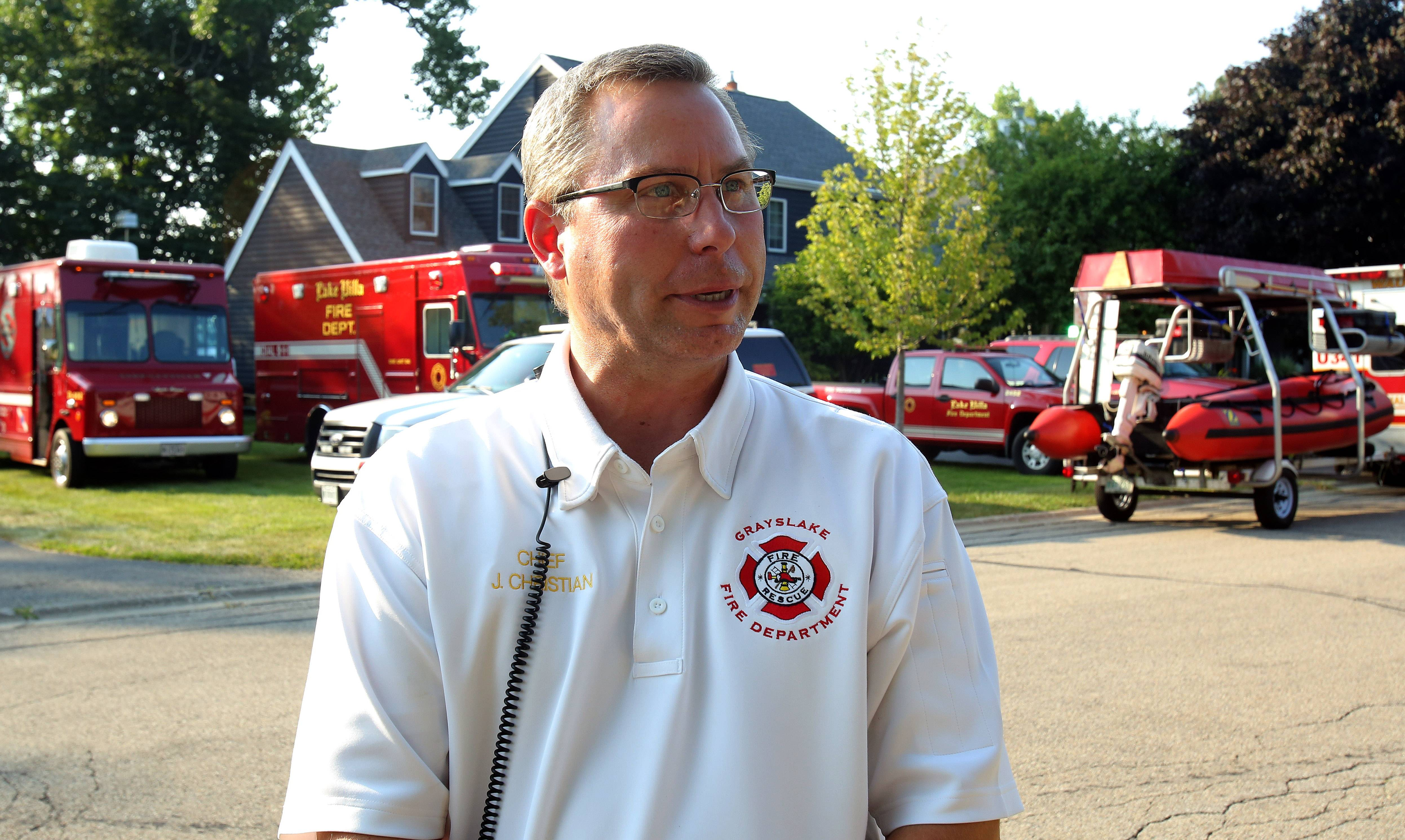 Grayslake Fire Protection District Chief John Christian talks to the media Monday afternoon near Third Lake, where the body of Grayslake Central High School student Matt Reed was recovered.