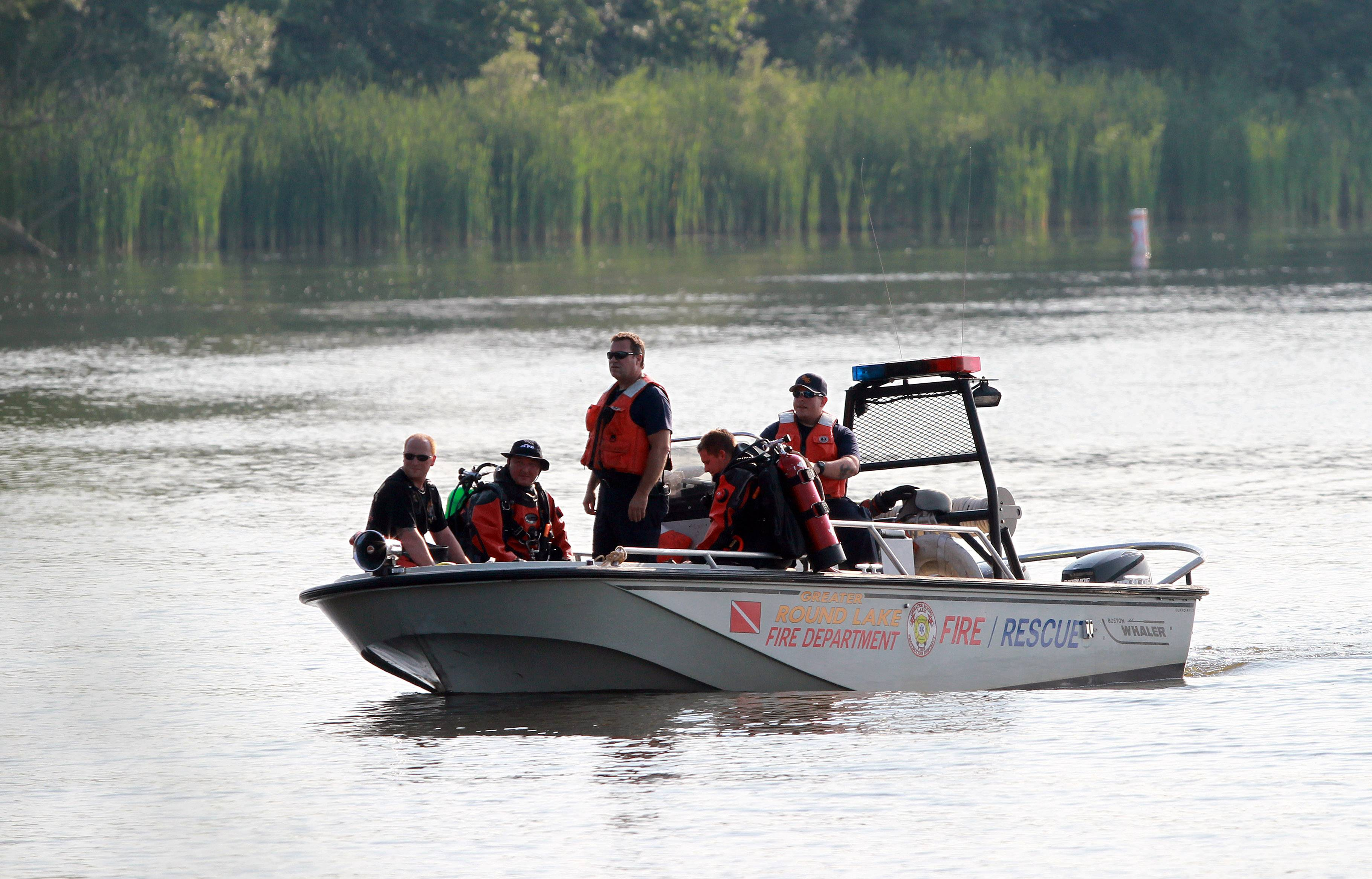 Divers searched the waters of Third Lake Monday afternoon for a missing Grayslake Central High School student. They recovered his body about 7 p.m.