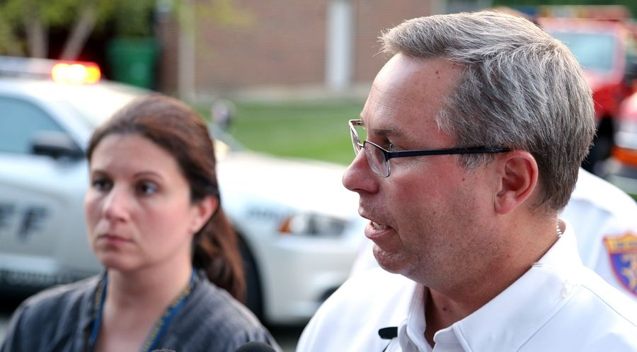 Grayslake Fire Protection District Chief John Christian, right, and Lake County sheriff's office Sgt. Sara Balmes address the media Monday night near Third Lake, where the body of Grayslake Central High School student Matt Reed was recovered.