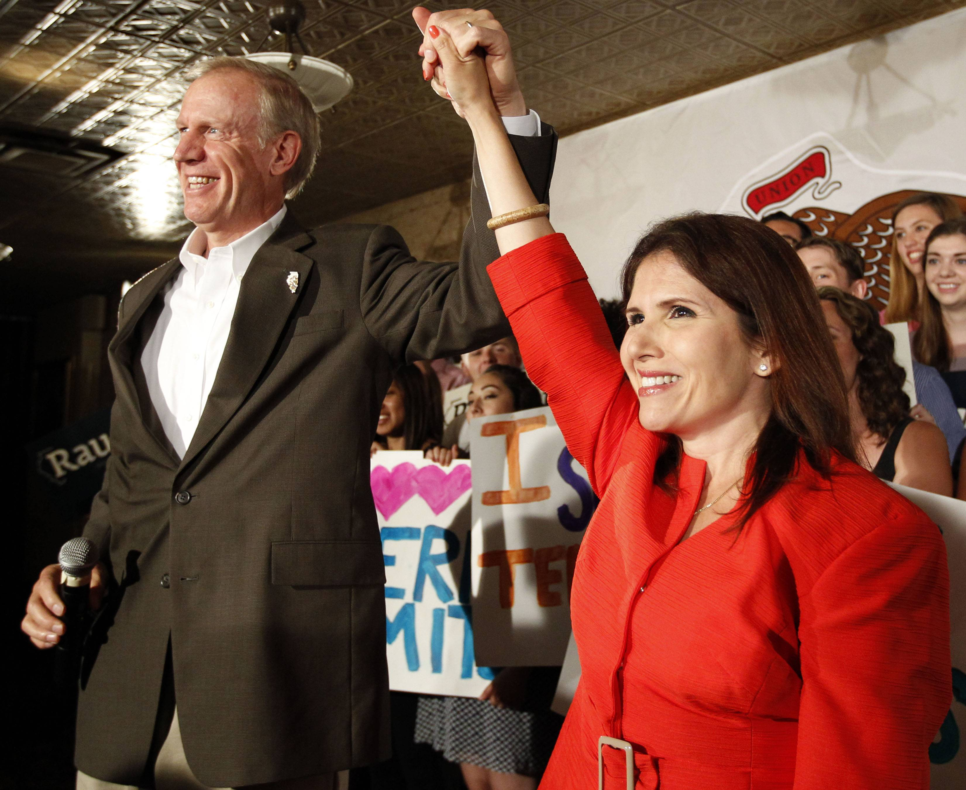 Republican candidate for governor Bruce Rauner stands with his running mate, Evelyn Sanguinetti of Wheaton, during a news conference Monday in Chicago. Rauner says he's continuing his efforts to impose term limits on Illinois legislators.