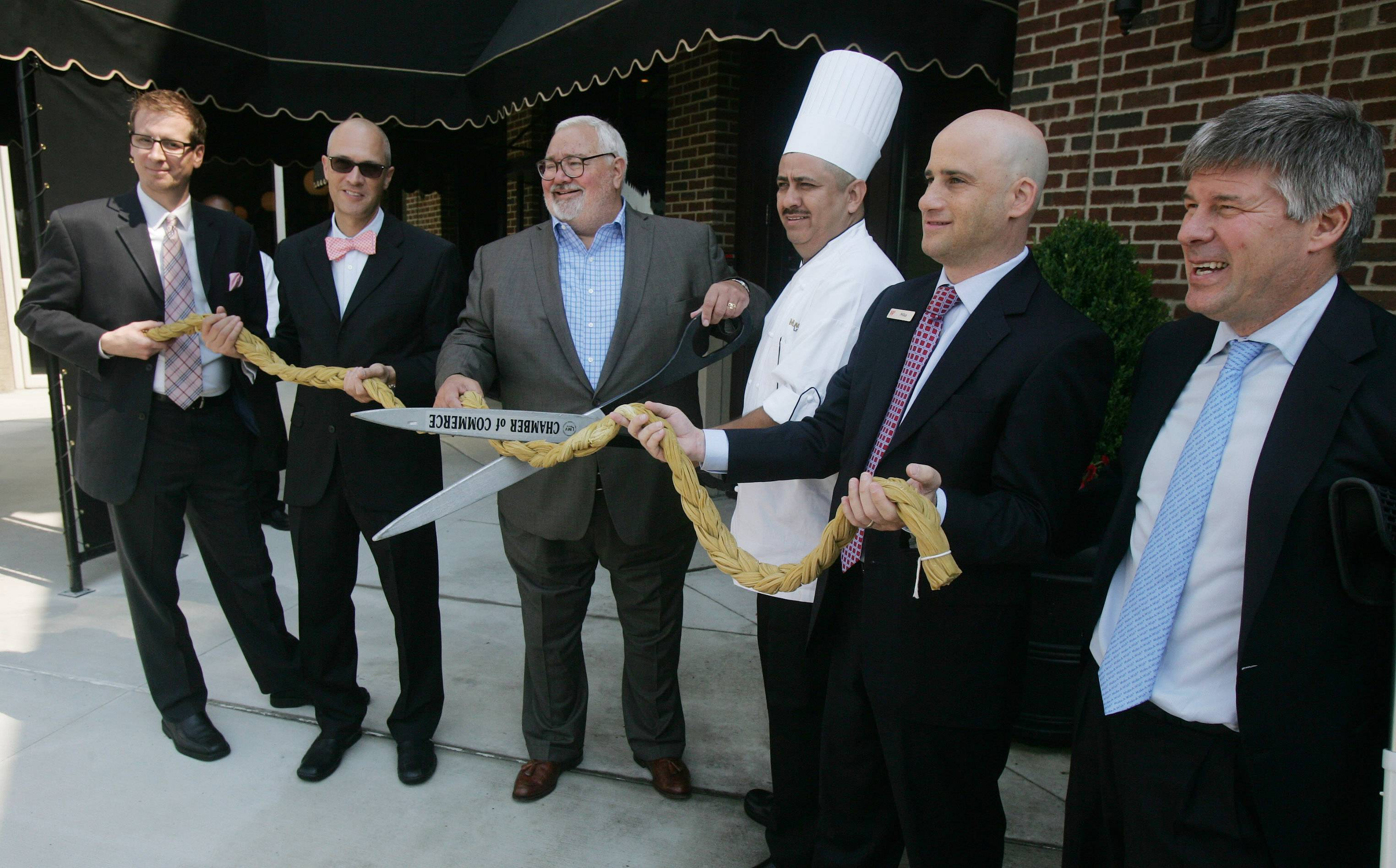 Vernon Hills Village President Roger Byrne holds the ceremonial scissors as a group of dignitaries cut a braid of pasta during the opening of Maggiano's Little Italy at Westfield Hawthorn shopping center Monday in Vernon Hills. This is the 47th Maggiano's nationwide. From left are Maggiano's Area Director Brian Moffitt, Maggiano's General Manager Ron Darnell, Byrne, Executive Chef Arturo Alvarado, Westfield Hawthorn General Manager Michael Golden and Maggiano's President Steve Provost.