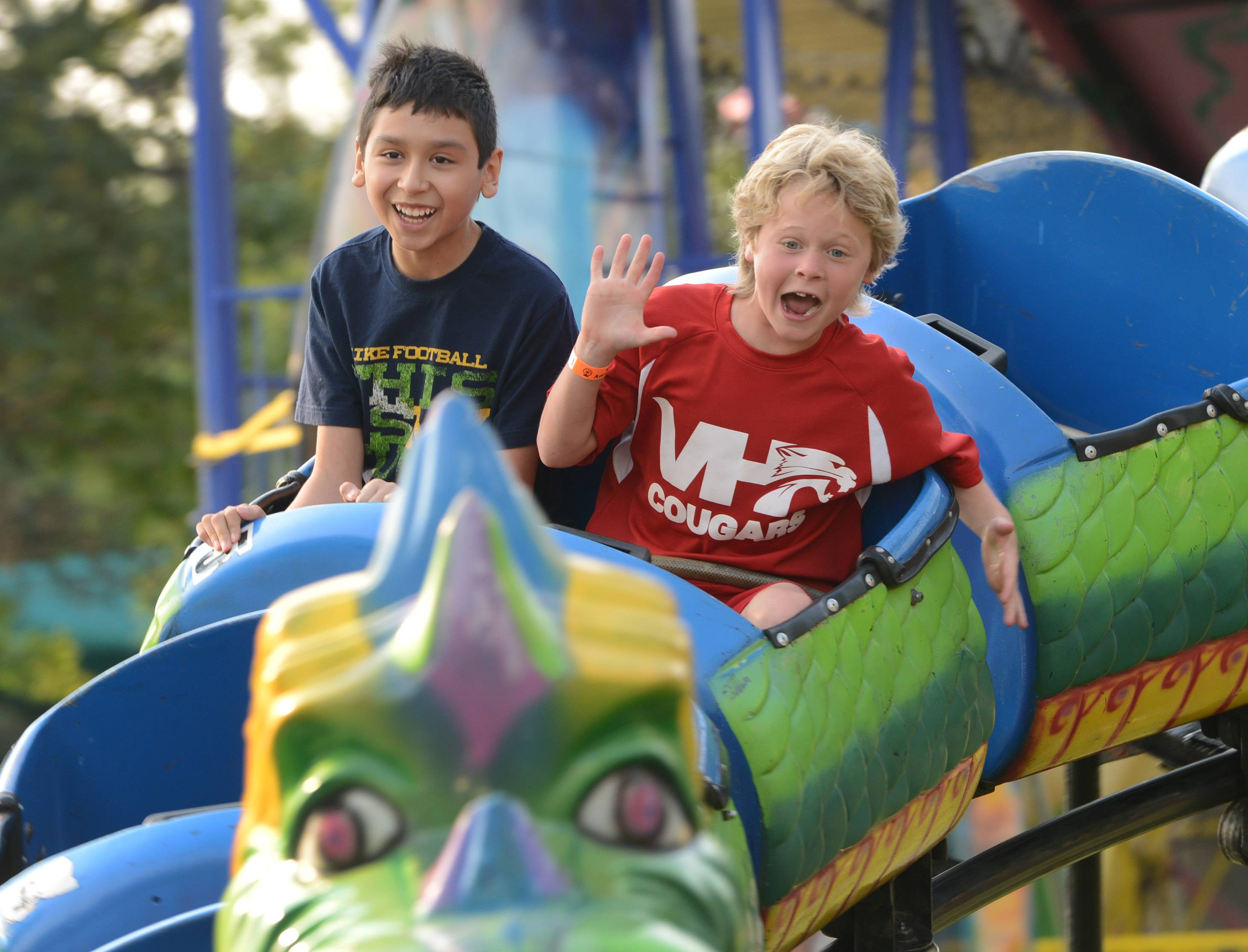 Alex Dominguez, left, 12, of Mundelein, and Jonathan Protus, 7, of Vernon Hills, enjoy the Dragon Wagon ride Thursday night at the Vernon Hills Summer Celebration in Century Park.
