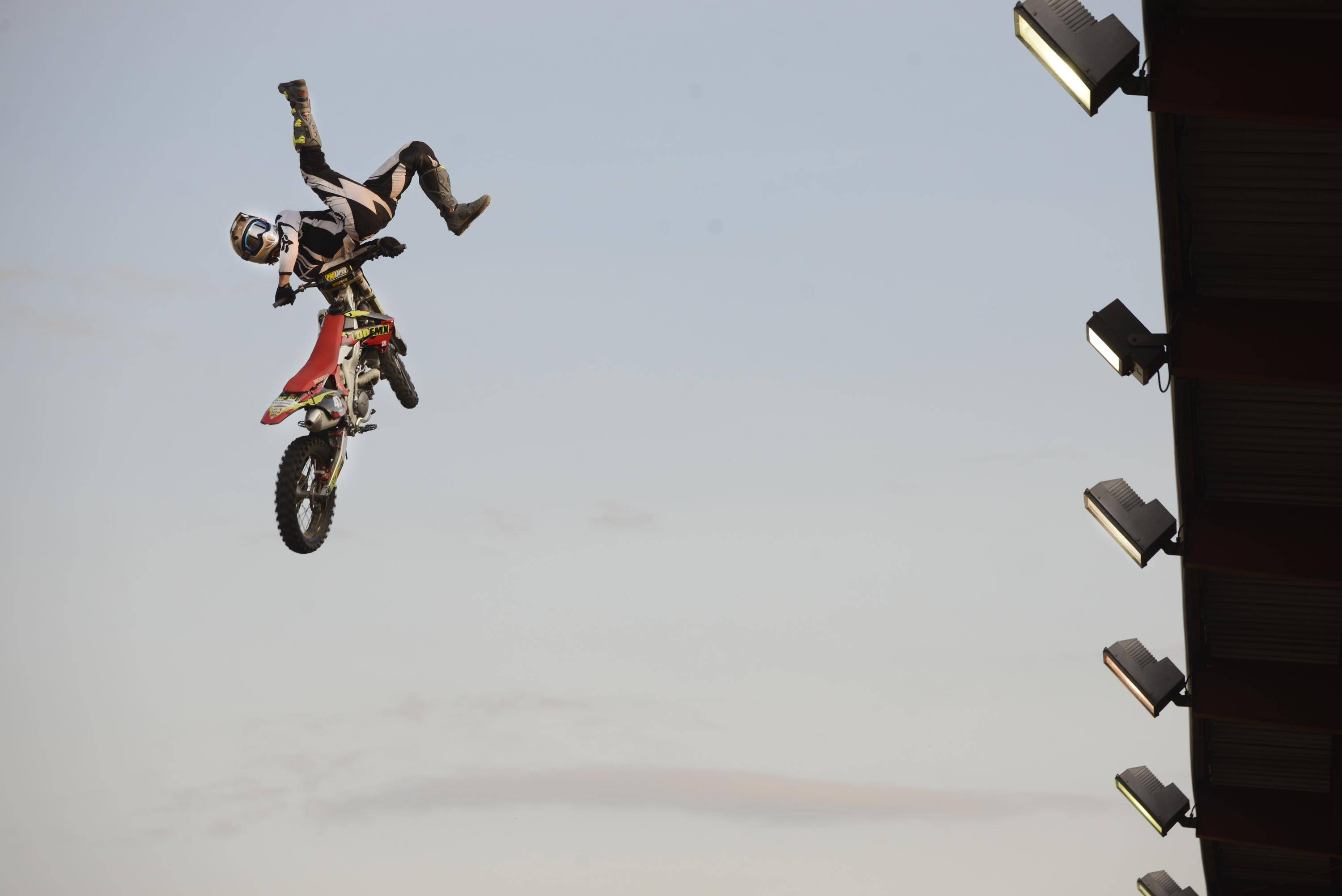 Austin Drummond, a professional freestyle motocross rider from Atlanta, flies past the grandstand lights Thursday night at the Freestyle Motocross Stunt Show at the Kane County Fair in St. Charles.