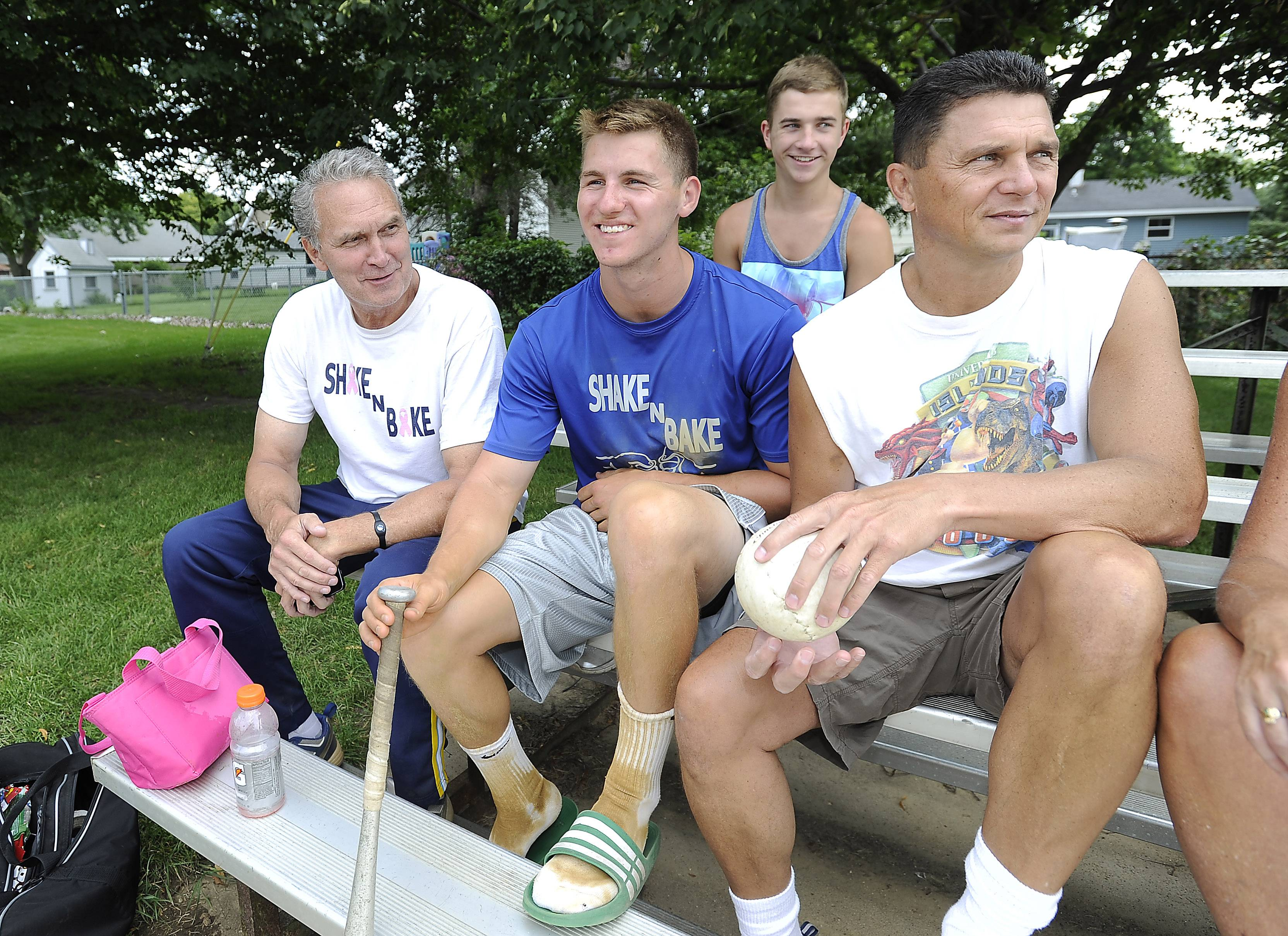 Patrick Moran, 21, middle, who is Terry Moran's son, hangs out with friends Tim Decker of Elk Grove, and Tony Prochenski of Des Plaines, between playing softball games at the 19th annual Terry Moran Memorial Softball Tournament in Rolling Meadows on Saturday.