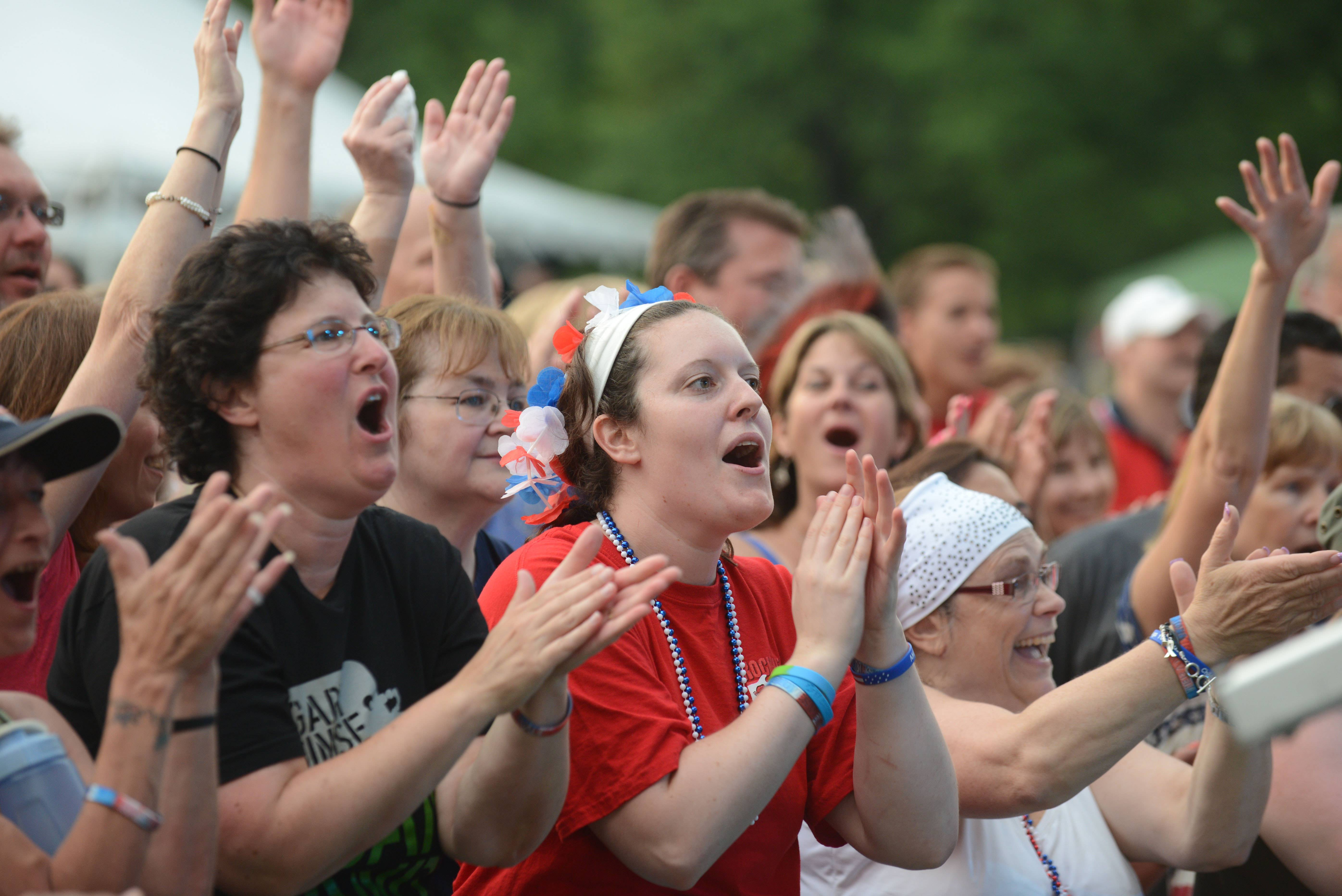 Fans sing and dance at The Rockin' for the Troops show at  Cantigny Park in Wheaton Saturday. It was sold out.
