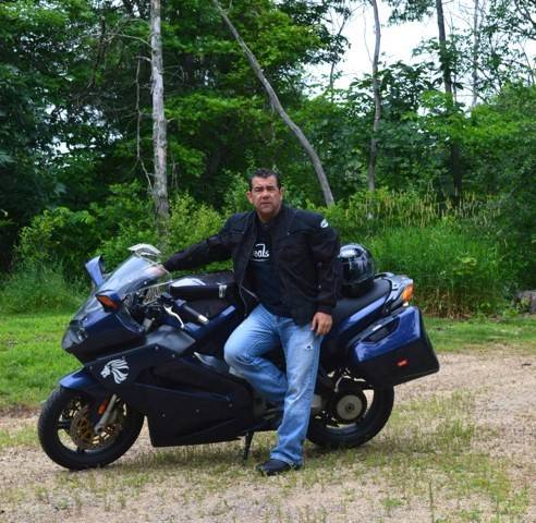 Naperville resident Jim Hughes has taken his Italian-made sports touring bike, an Aprilia, on several Wounded Heroes rides to visit disabled veterans, bring them care packages, and raise money to help them transition back to civilian life.