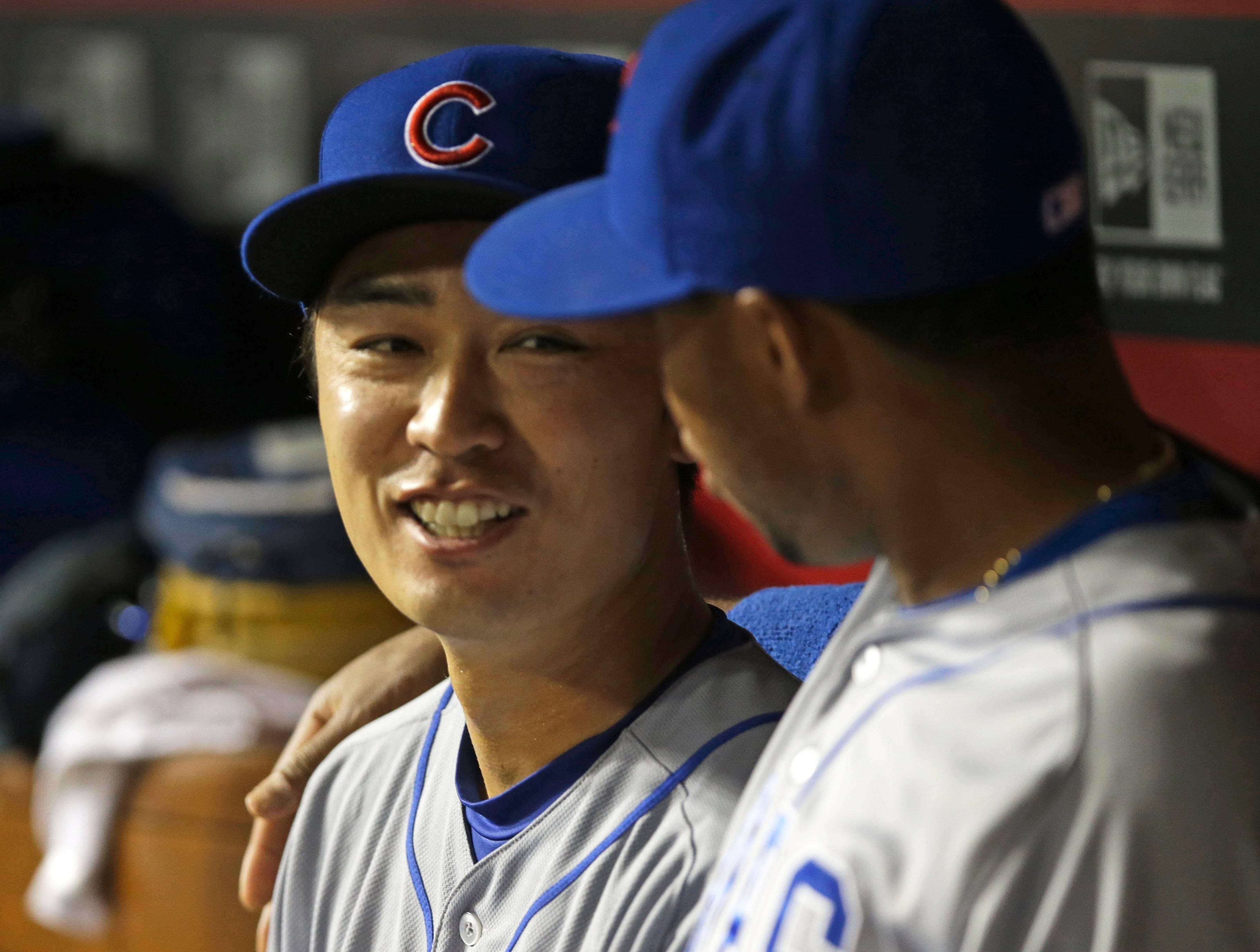 Cubs starting pitcher Tsuyoshi Wada, left, talks with Luis Valbuena in the dugout in the sixth inning of a baseball game against the Cincinnati Reds, Tuesday, July 8, 2014, in Cincinnati.