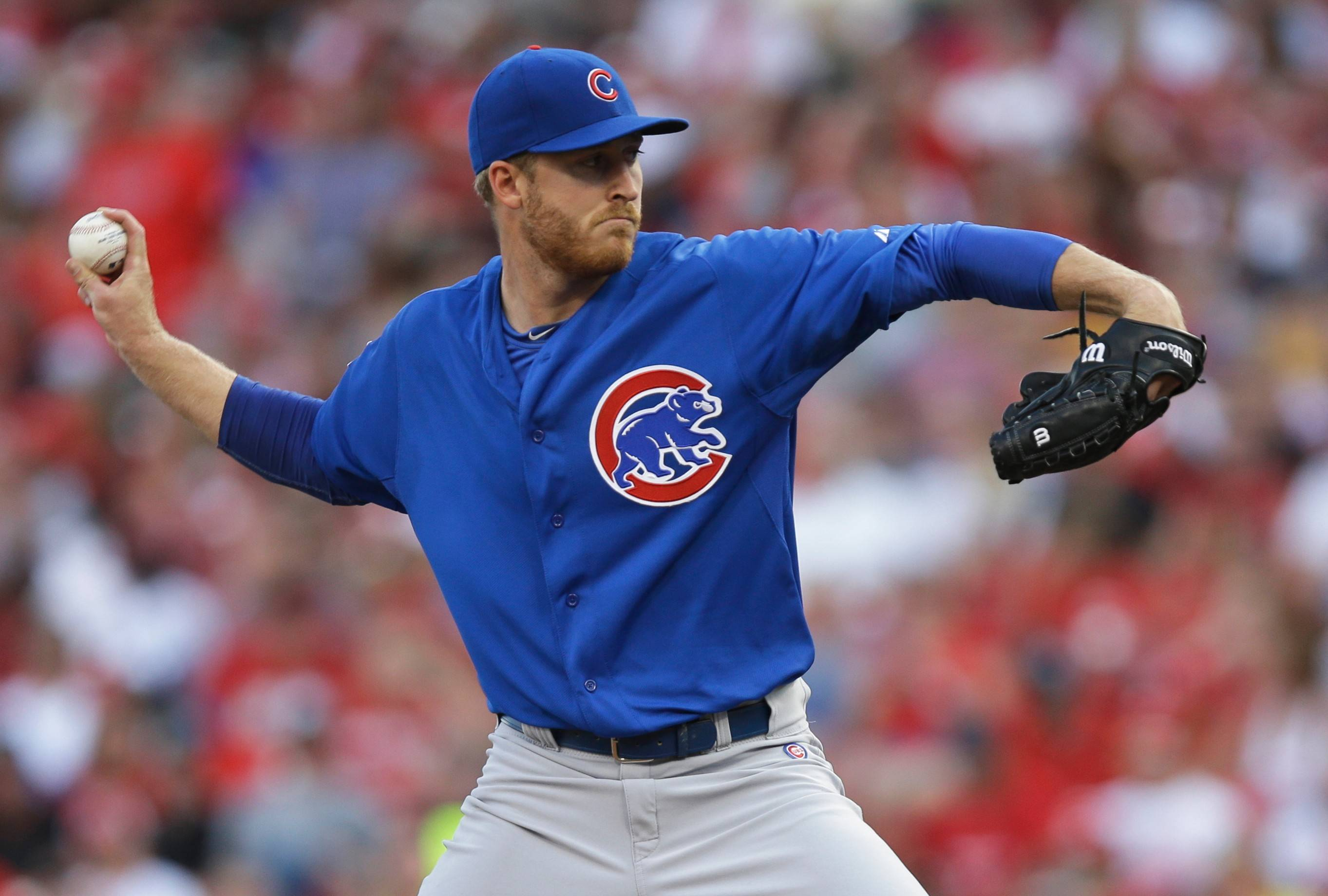 Cubs starting pitcher Dallas Beeler throws against the Cincinnati Reds in the third inning of a baseball game, Wednesday, July 9, 2014, in Cincinnati.