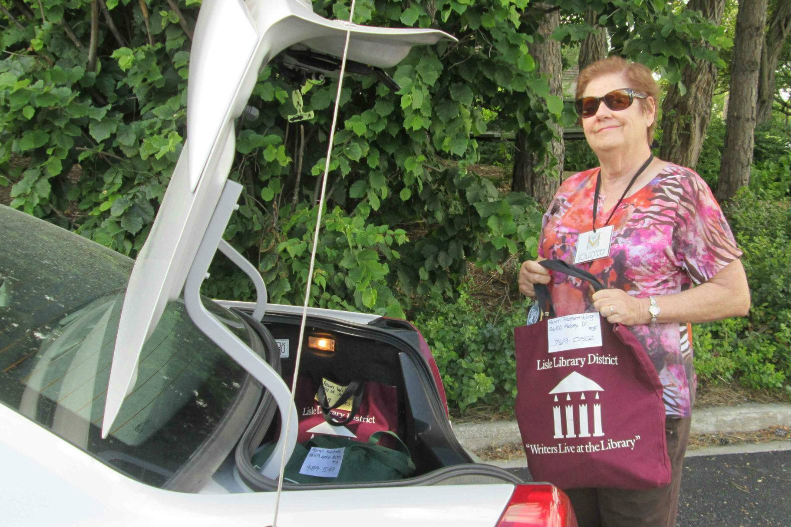 Longtime library volunteer, Kathy Schwandt, loads her car with materials for patrons who use Lisle Library's home delivery service. For more information, visit lislelibrary.org.Nicole Mueller