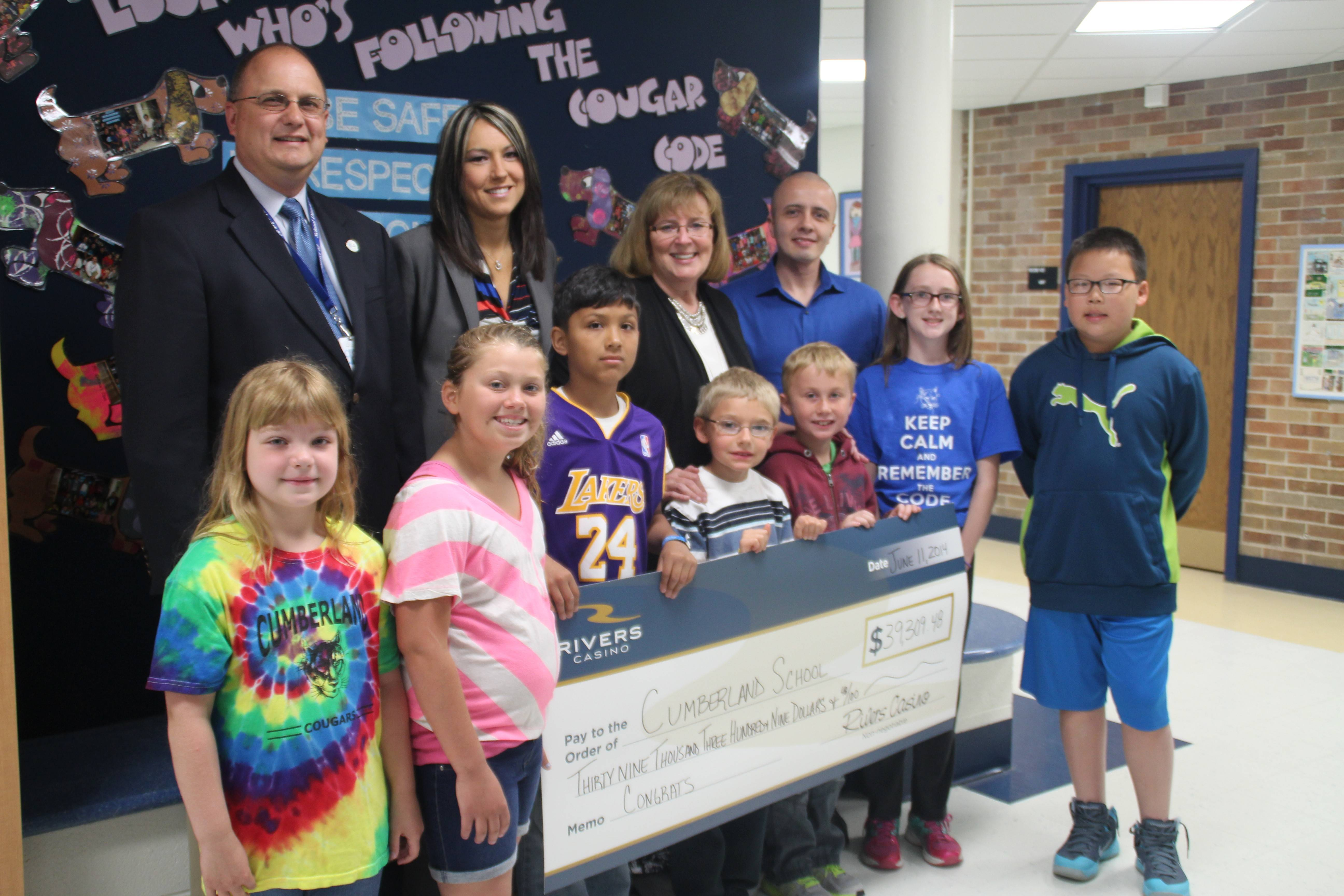 Beginning this fall, more computers will be available to Cumberland students because of a generous grant from the Rivers Foundation. Pictured, from left, are: Front row: Jayden Chelberg, Allison Swanson, Andrew Cruz, Jacob Krieger, Alex Krecu, Aileen O'Connor and Daniel Choi; rear row: Dist. 62 Associate Superintendent Paul Hertel; Jill Wilcox, Rivers Foundation, Colleen White, Cumberland principal and Jackey Valadez, Rivers Foundation.