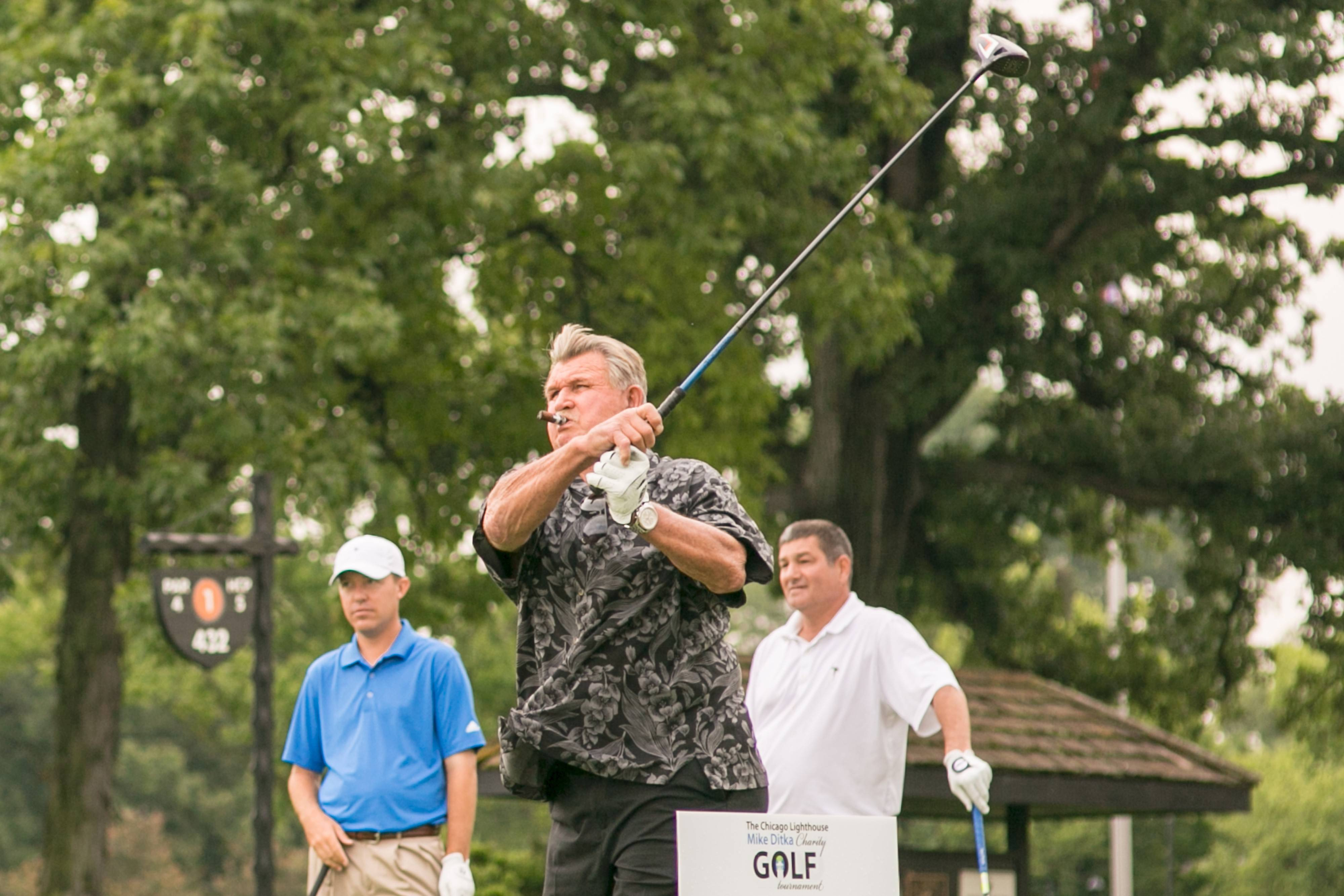 Mike Ditka tees off at The Chicago Lighthouse's second annual Mike Ditka Charity Golf Tournament, held at the North Shore Country Club in Glenview.