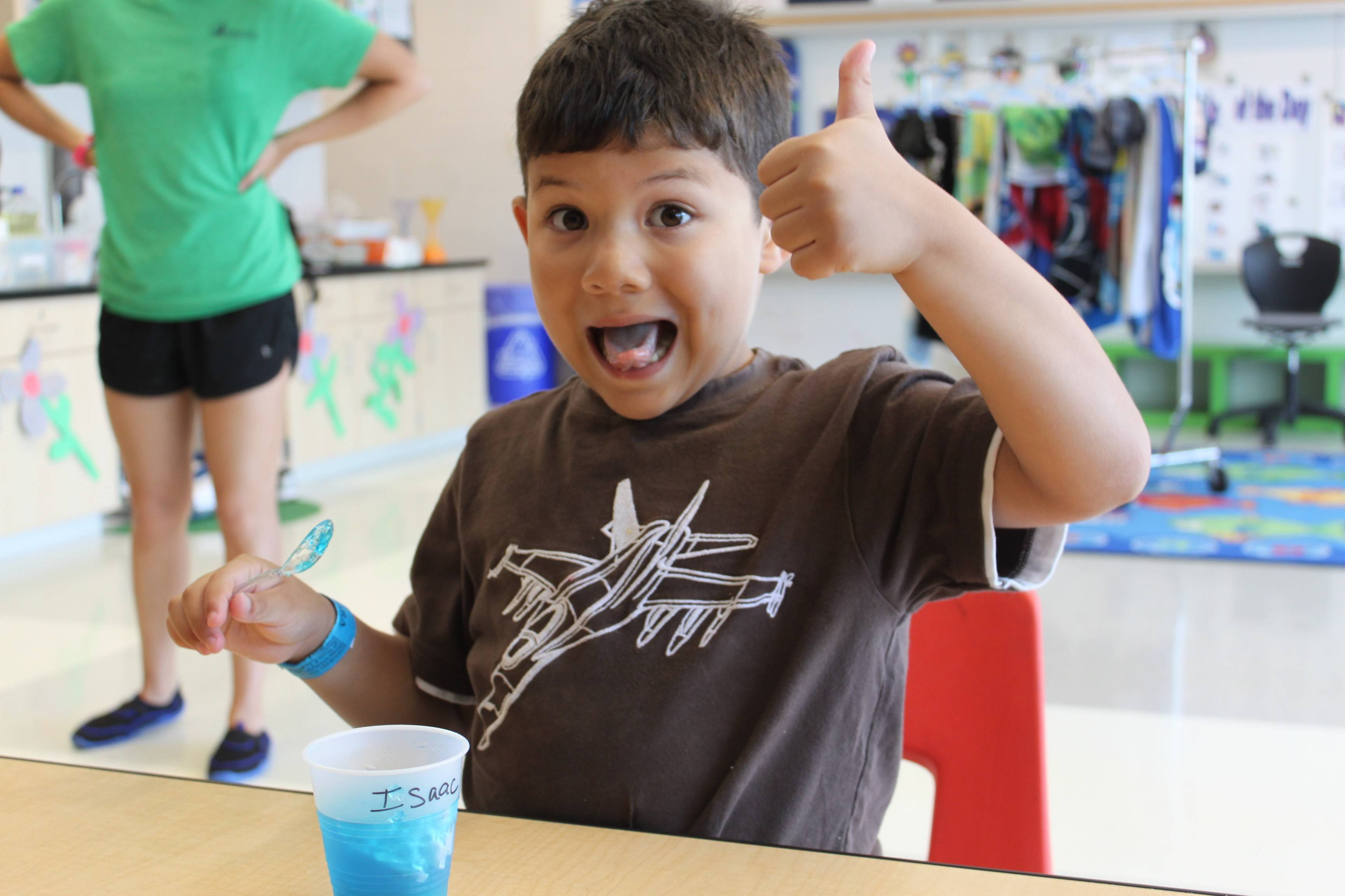 Issac enjoys a Jell-O snack at NEDSRA's Little Explorer summer day camp.