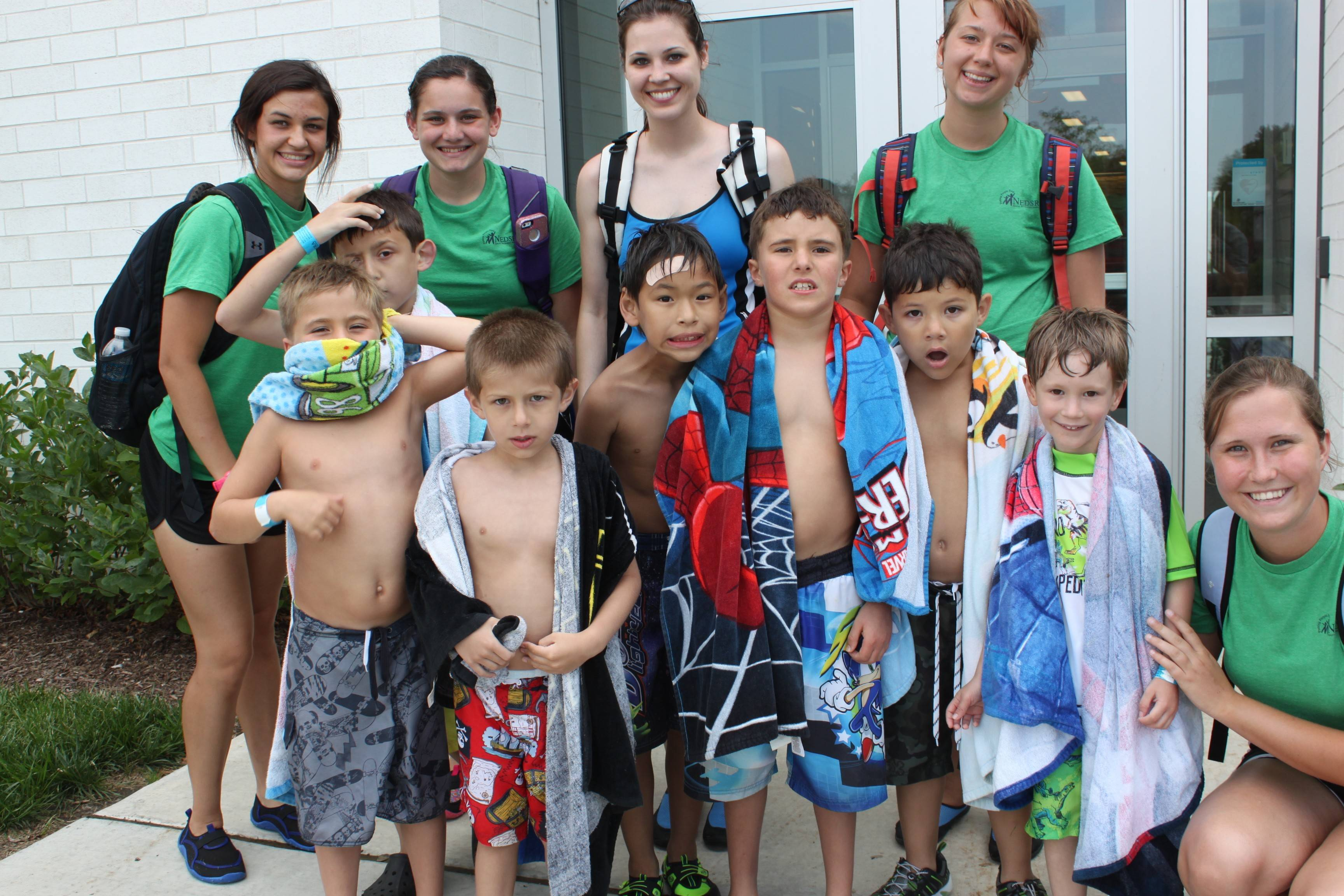Camp leader Erin Mikulecky, back row wearing a blue shirt, and her staff are keeping campers with special needs busy with trips to pools and other activities in the Little Explorer summer day camp.
