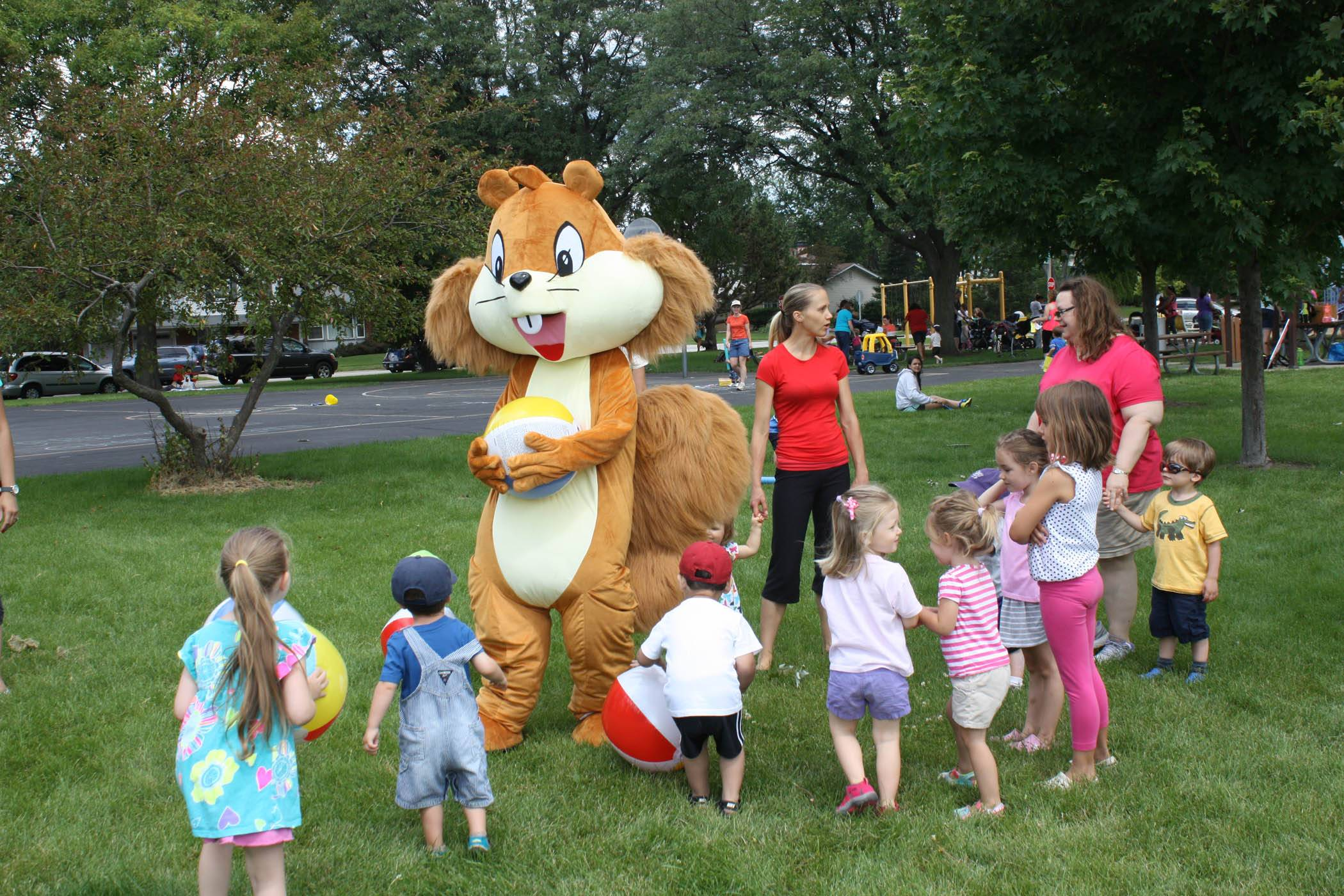 Sammy the Squirrel, Palatine Park District's new mascot, plays with children during the July 9 Play in the Park Day.Palatine Park District