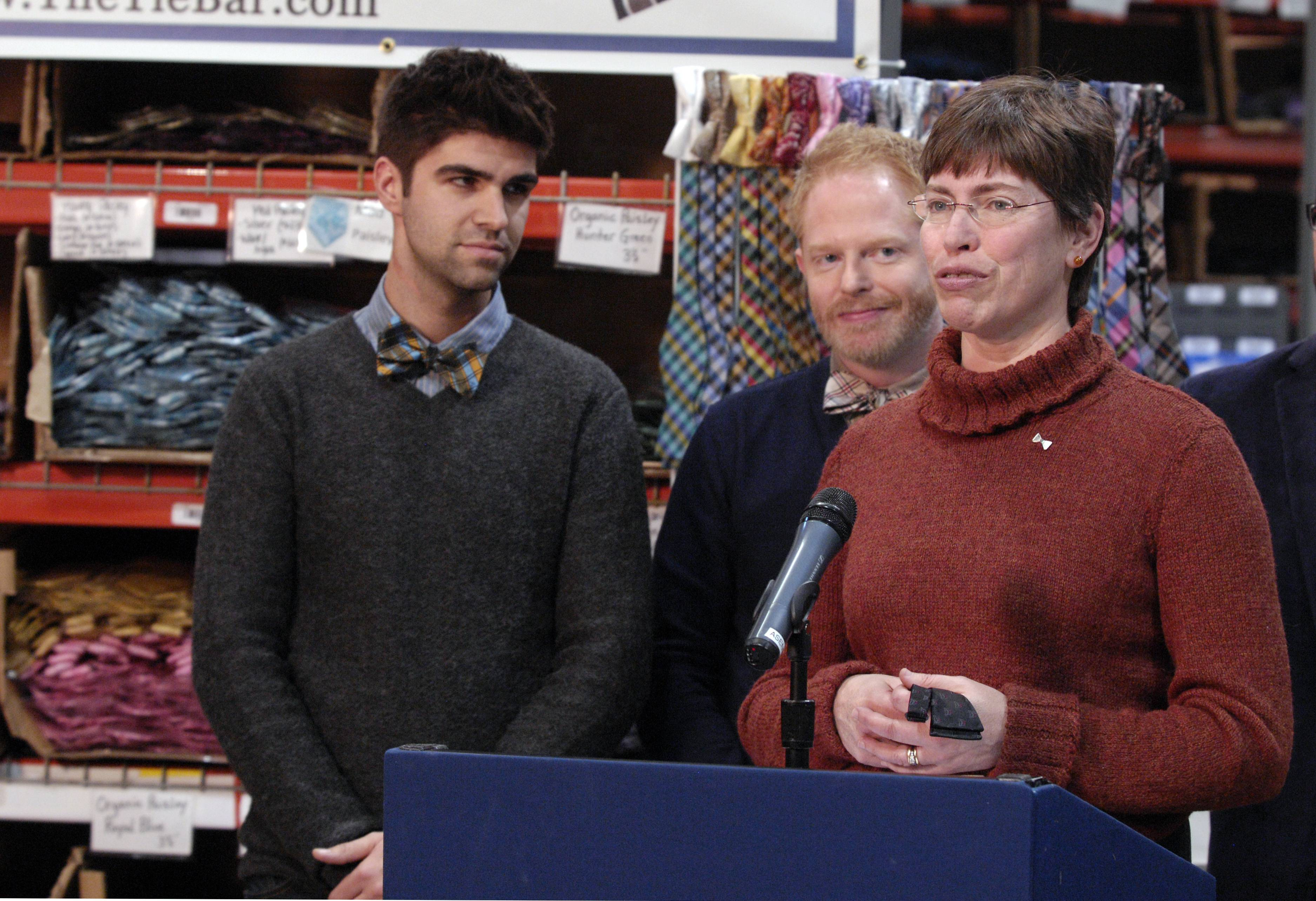 "Lt. Gov. Sheila Simon speaks at The Tie Bar.com office in Naperville in 2013 with Jesse Tyler Ferguson, a star on ABC's ""Modern Family,"" and his fiancee Justin Mikita, left, to launch ""Bow Tie Lobby Day"" to support marriage equality."