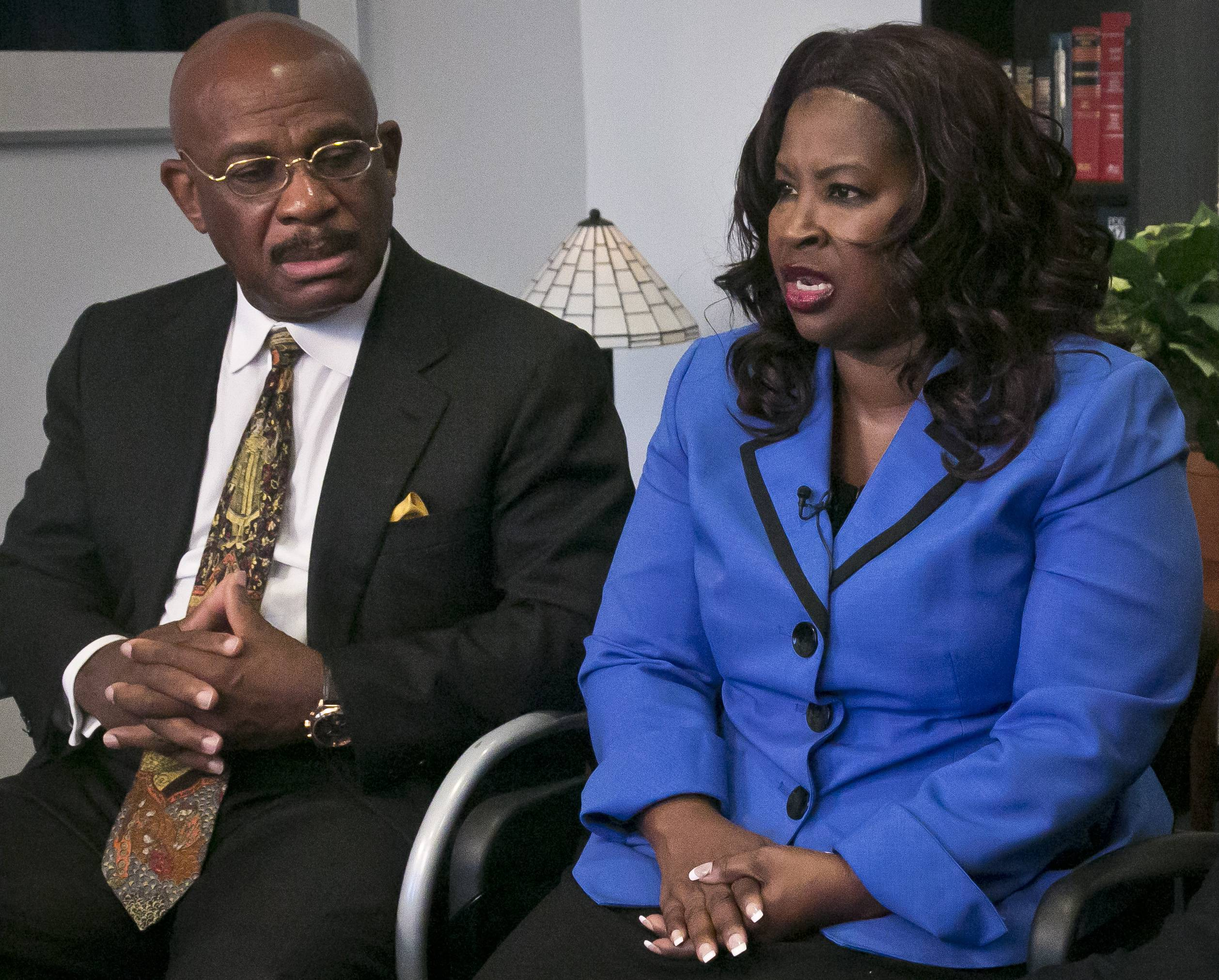 Attorney Willie Gary, left, listens as Cynthia Robinson speaks during an interview in New York. Gary represented Robinson in a lawsuit against R.J. Reynolds Tobacco Co.
