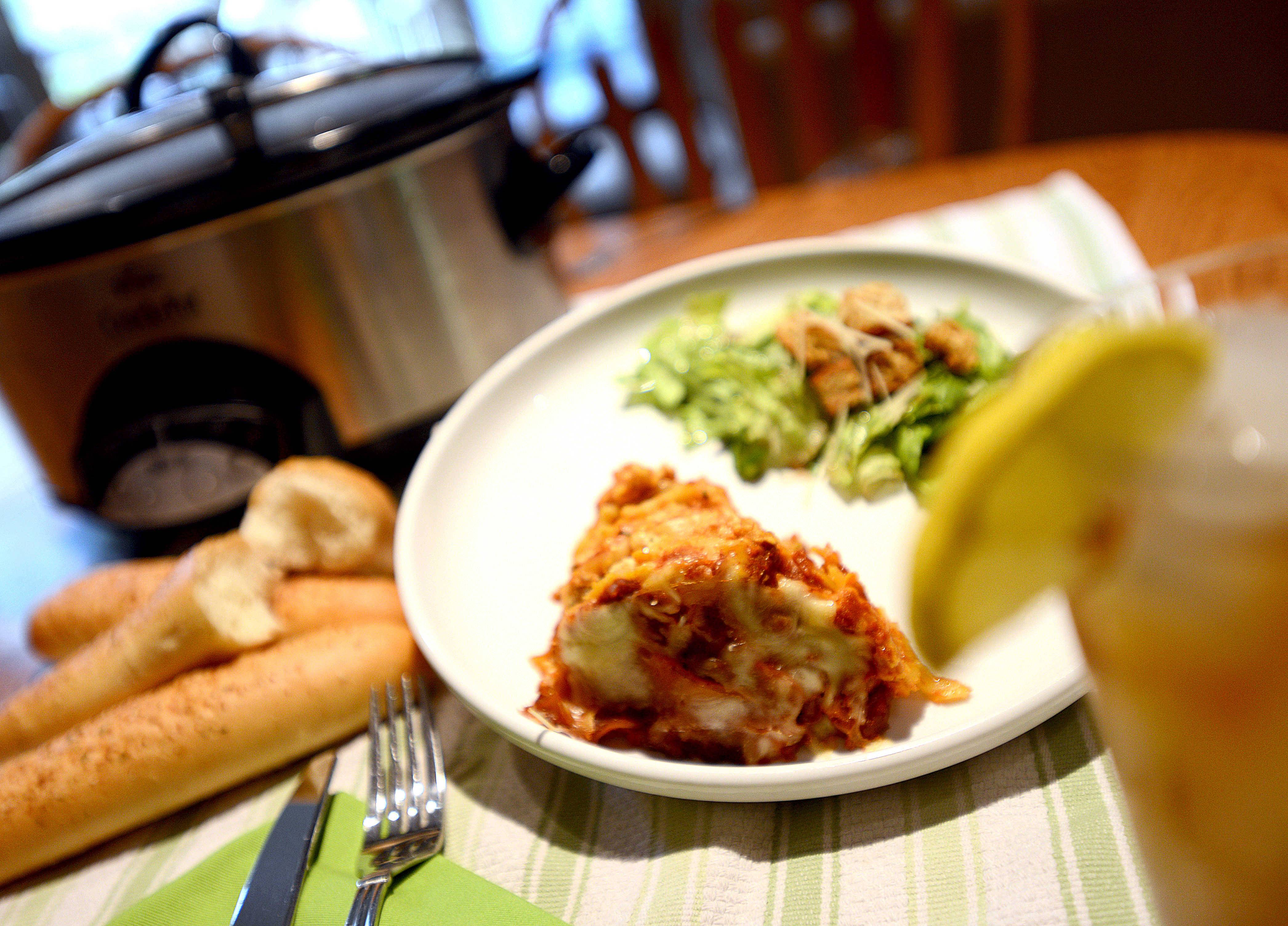 "With her kitchen torn up for remodeling, Penny Kazmier turned to her crockpot to ""bake"" a Italian sausage lasagna."