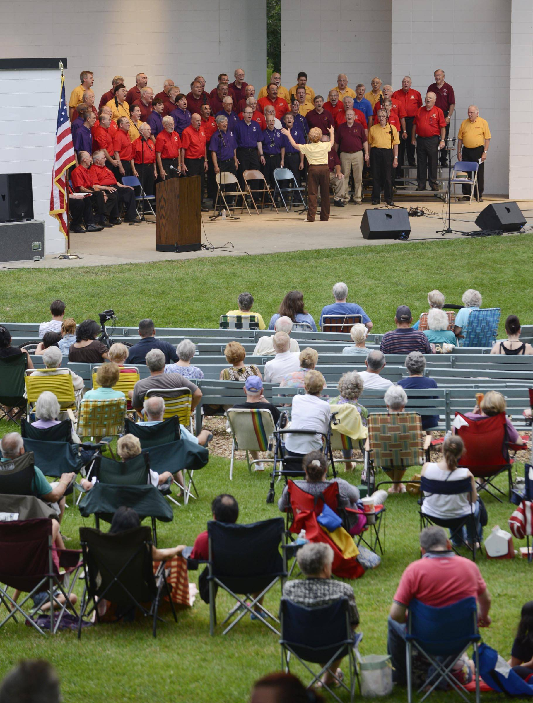 Northern Illinois Barbershop Chapters, a 100-man mass chorus, performs in the band shell at Wing Park Tuesday night as part of the Harmony Fest 2014.