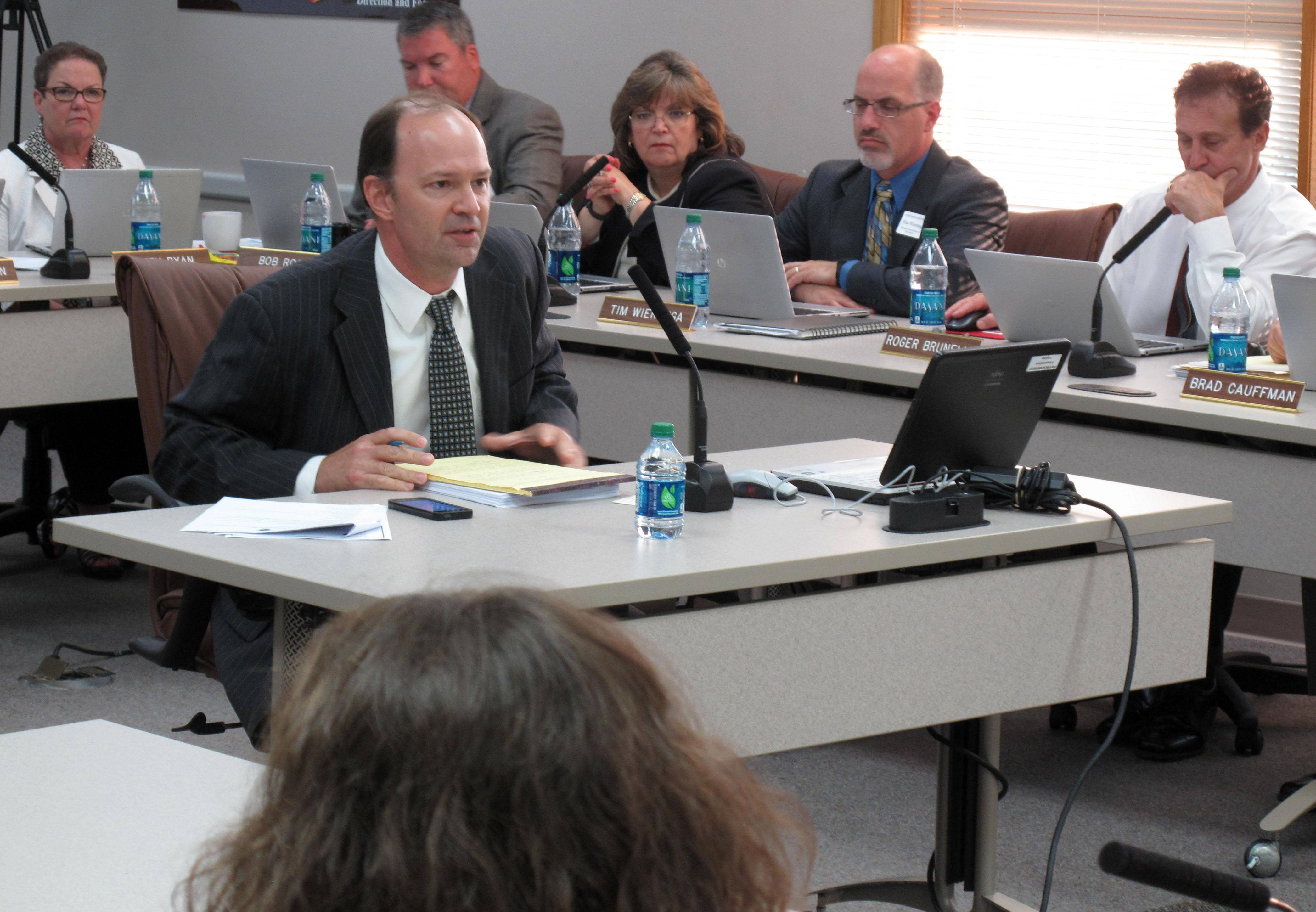 Naperville Unit District 203 resident Rodd Elges tells school board members Monday night that they should reject a proposal from AT&T to install cell towers at Kennedy and Lincoln junior highs.