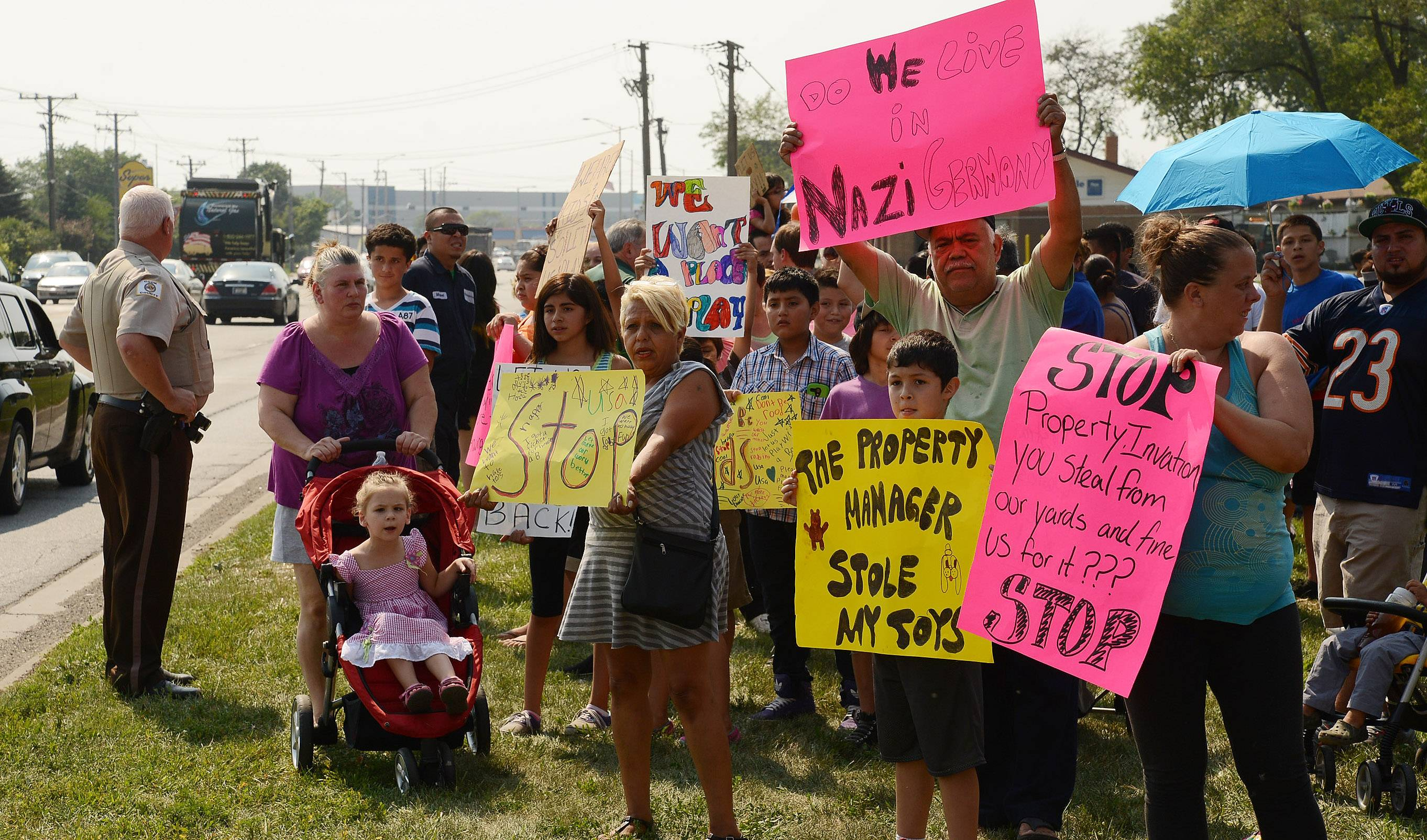 Mobile home park residents protest after manager removes belongings from yards